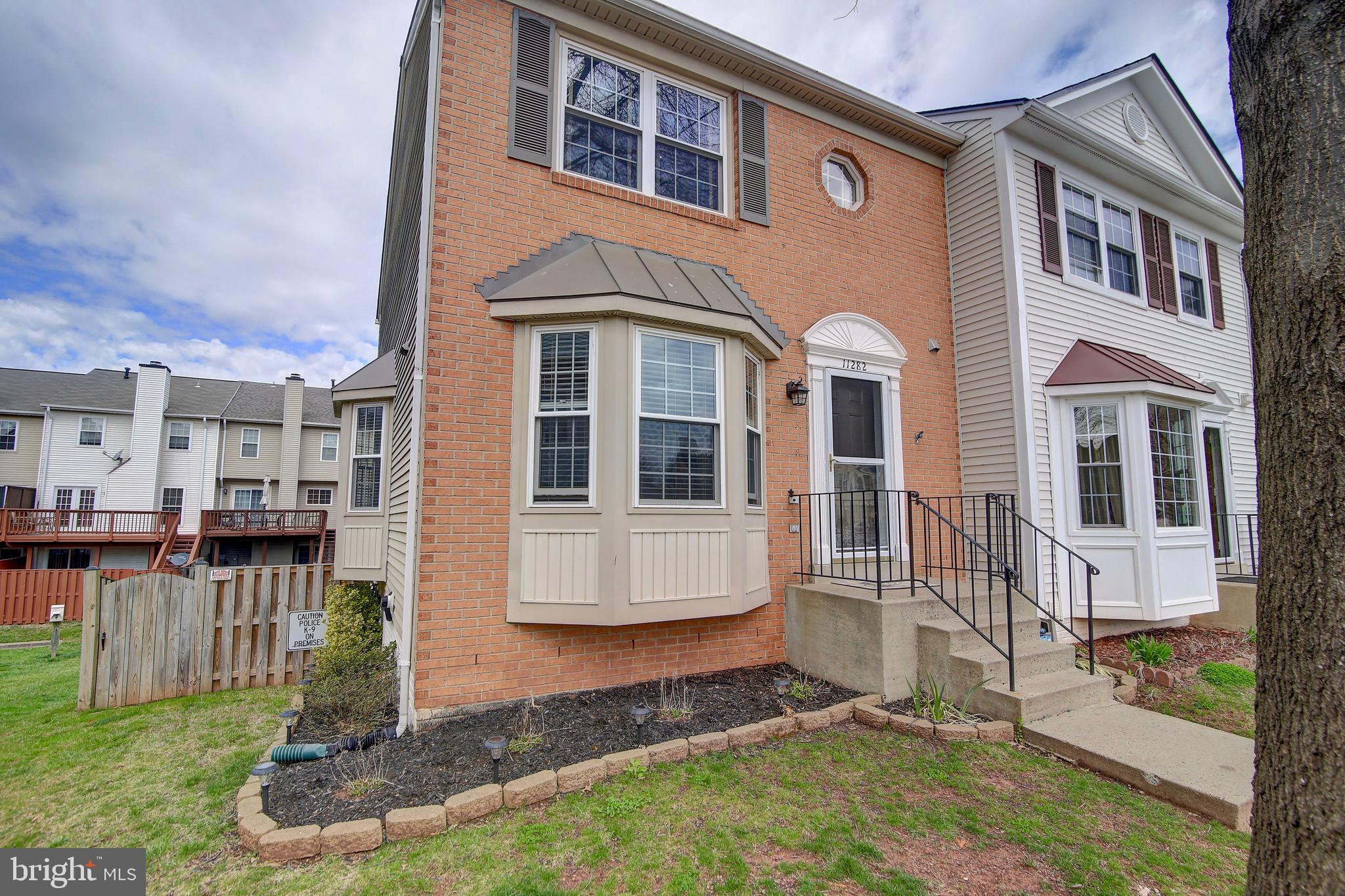 Welcome Home! Beautifully updated end-unit three-level townhome with a walk-out basement in the cove