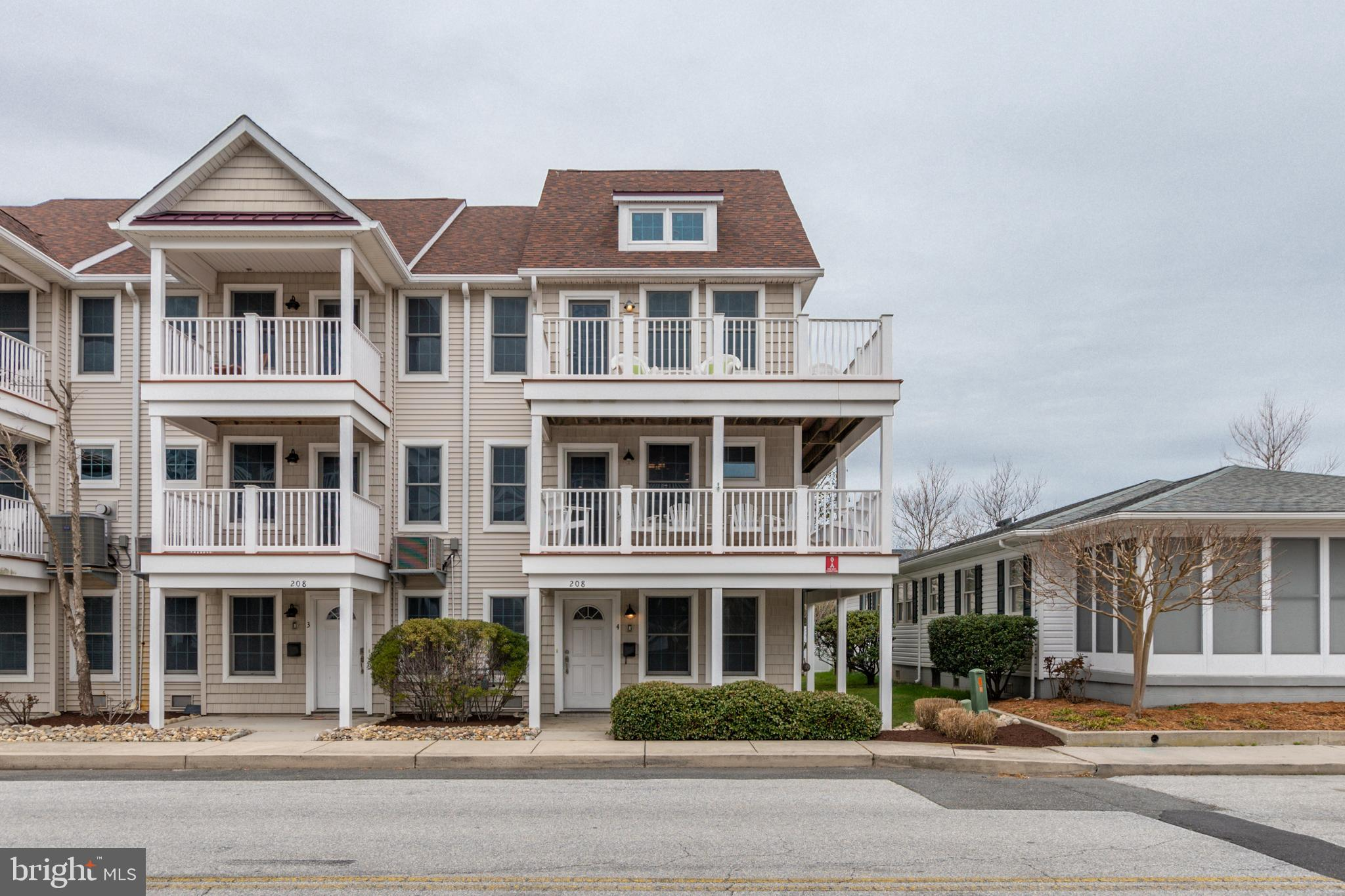 This 3 bedroom 2.5 bath 1700 sq. ft. end unit townhouse is a must see. There is an additional room that can be used as a 4th bedroom or a den. Fully furnished, freshly painted, hardwood floors, gourmet kitchen, gas fireplace, laundry room, large 2 car garage, tons of outdoor living space with bay views and just steps to the beach and Boardwalk. Great location on 7th street and Saint Louis Avenue. Enjoy two free fishing piers, as well as the Downtown Recreation Complex along the bay where you find a ballfield, playground, basketball courts, tennis courts, and the Ocean Bowl Skate Park. Restaurants, shopping, amusements, and the White Marlin Open fishing tournament are all within a short distance.