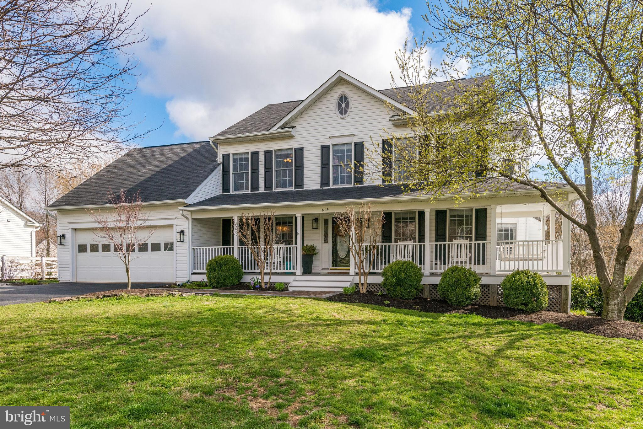 Beautiful Colonial situated on a quiet Corner Cul-de-sac lot, with Wrap Around Porch , & Mature Tree
