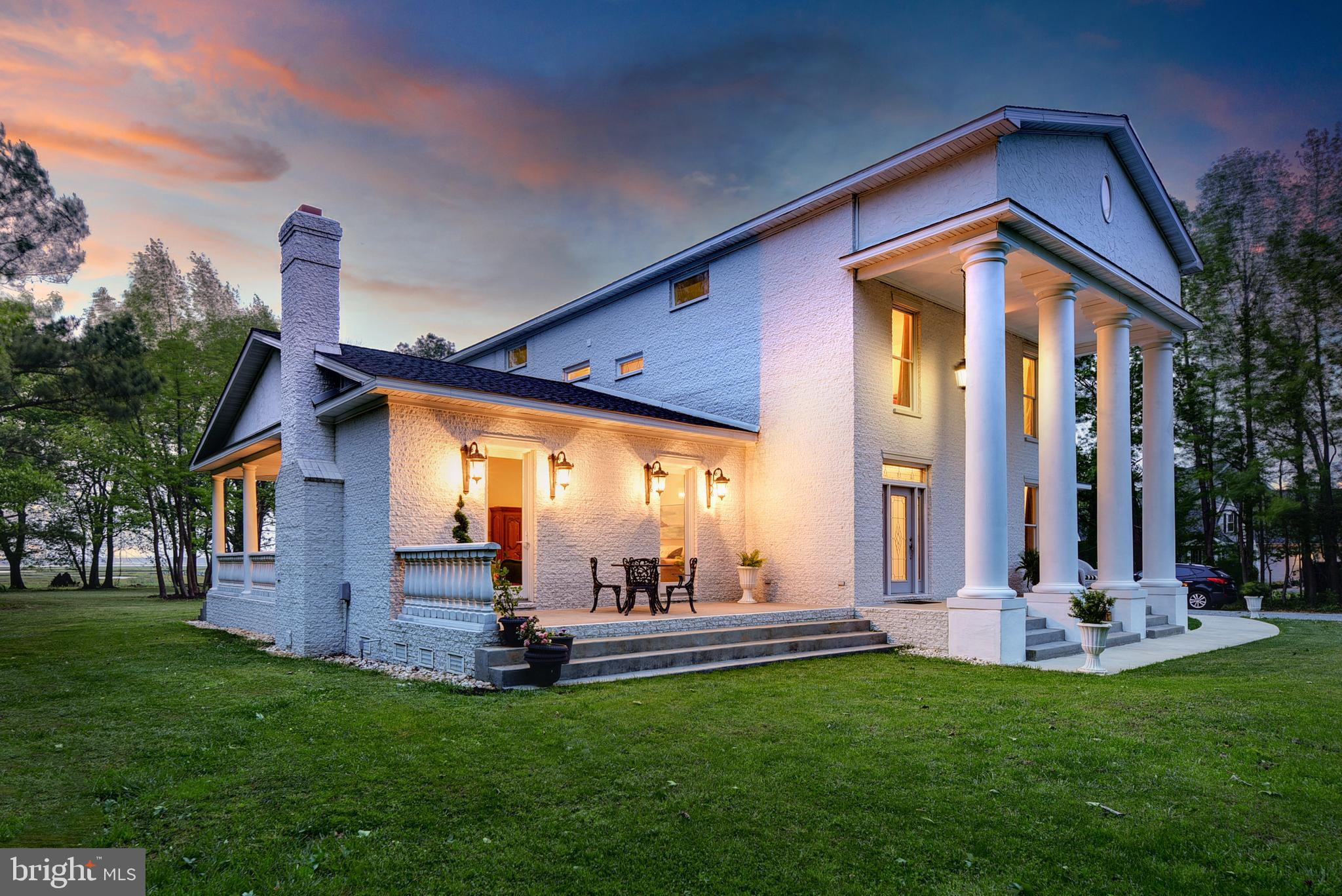 NO HOA FEES. Custom built solid white brick WATERFRONT GEM with acreage. A SOUTHERN STATELY  home es
