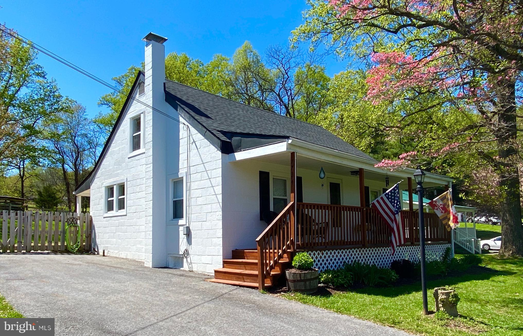 Charming well-maintained 4 bedroom, 2 full bathroom Cape Cod on .55 acres , USDA eligible and one ye