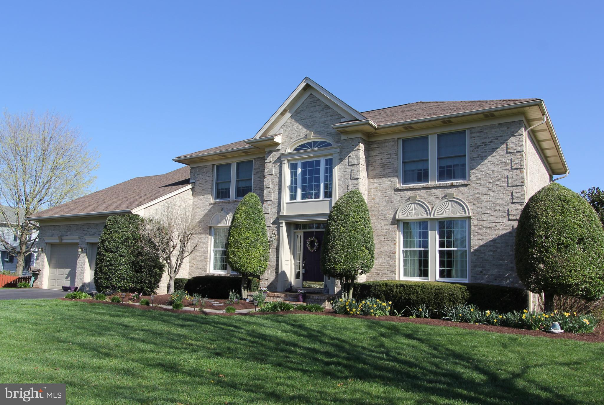 Welcome to this fabulous all-brick four bedroom, 2.5 bath custom colonial on .75 acre flat lot in Cl