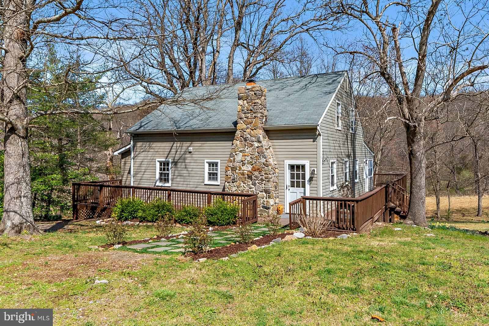 Newly renovated, move in ready charming cottage on private, expansive wooden lot. Approximately 4 ac