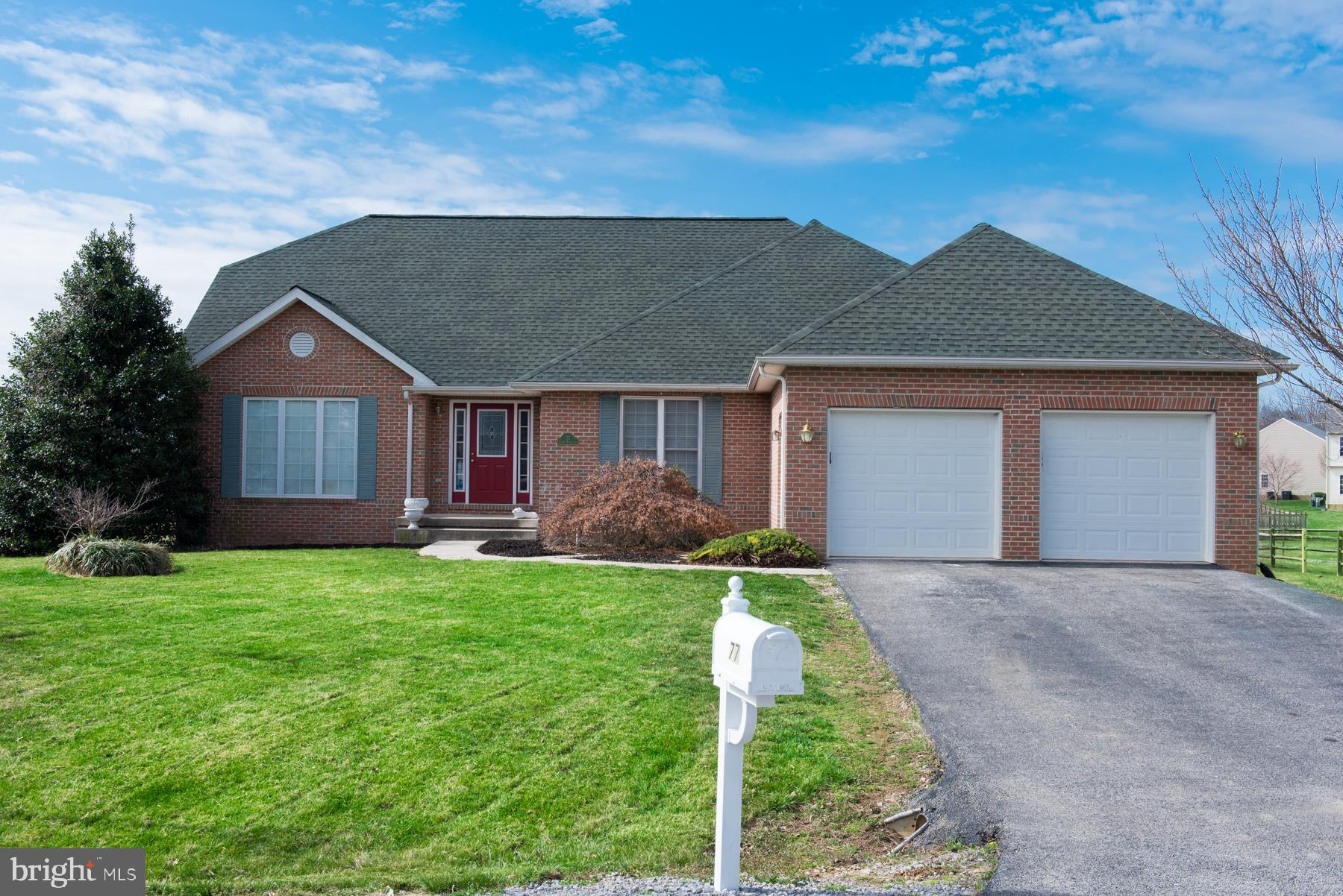 Beautiful brick front Rancher situated in Locust Hill Golf Course S/D. This stunner offers 3 bedroom