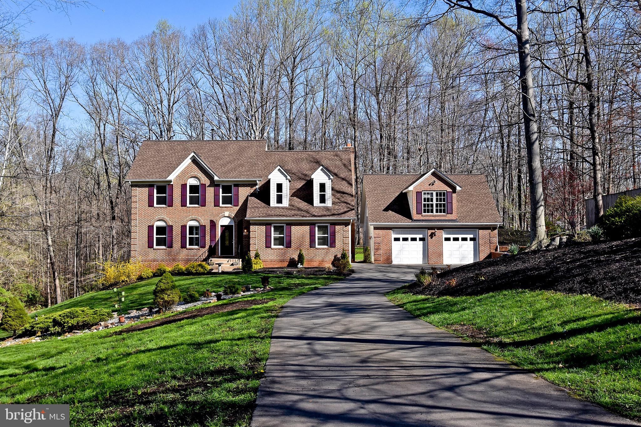 This beautifully renovated four bedroom, three and one half-bath colonial tucked away on a 2+ acre p