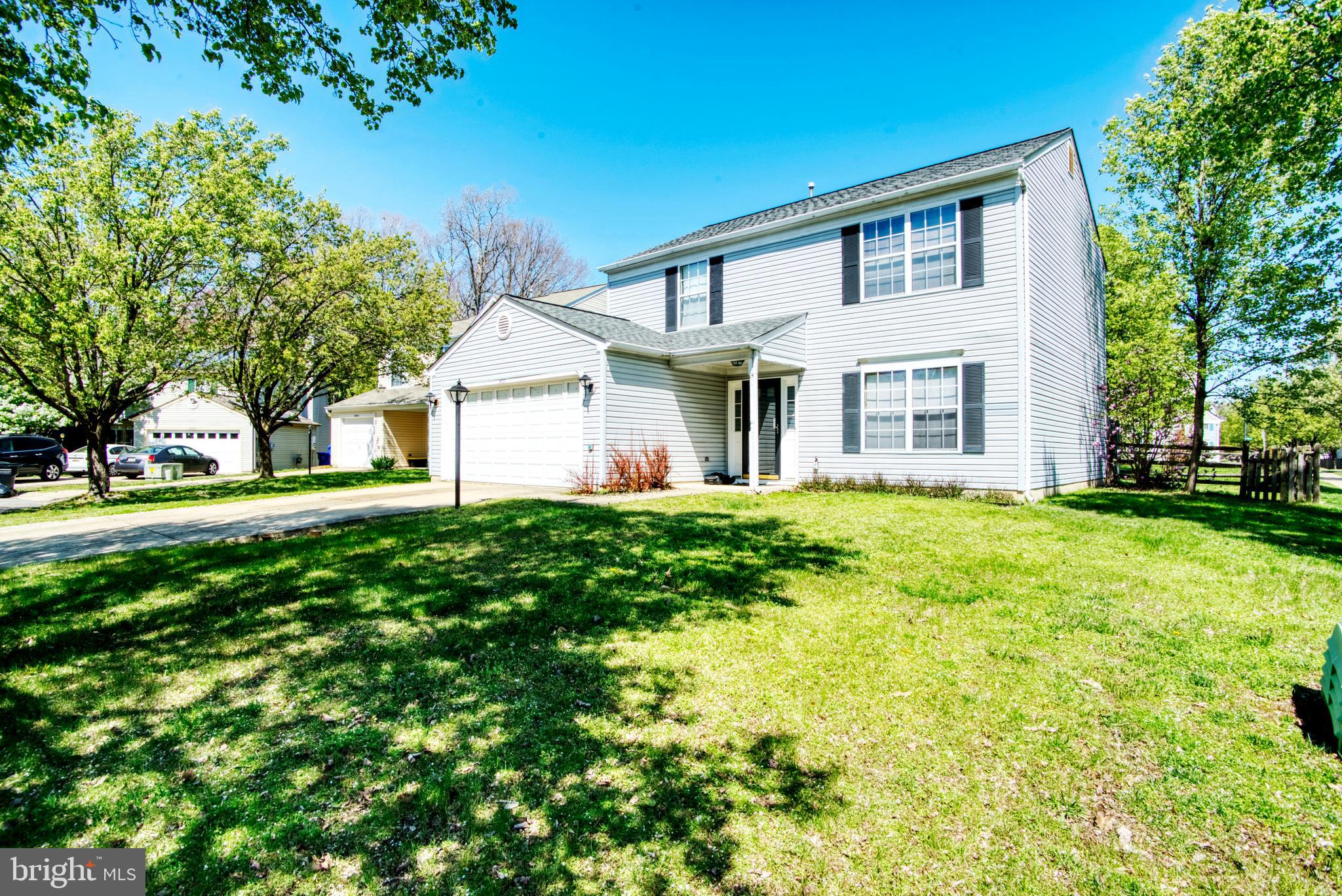 Bright and Spacious Starter Home!! This colonial sits on a landscaped, premium corner lot in a cul-d