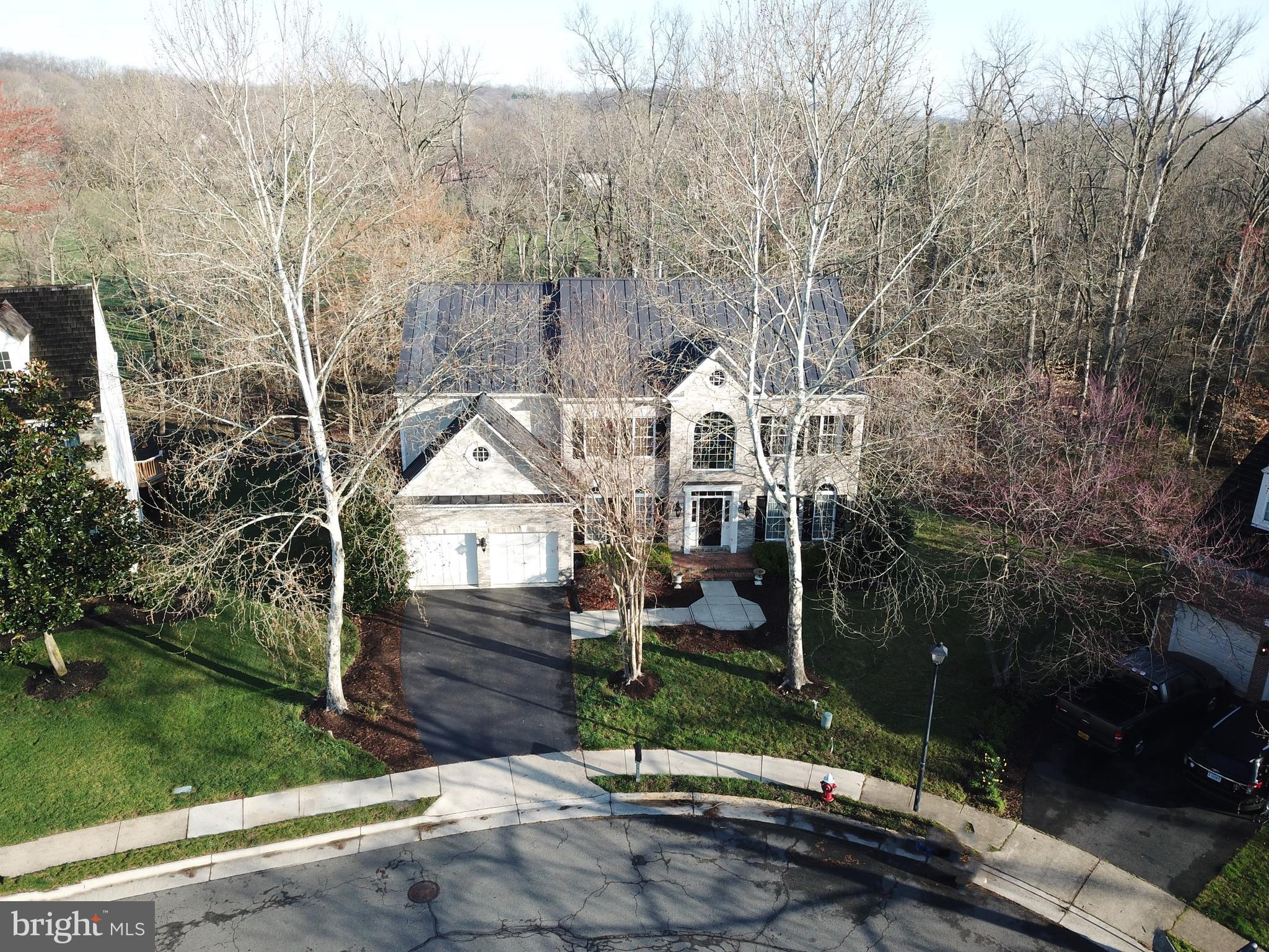 Stately colonial on extremely rare 1/2 acre + premium  cul de sac lot in highly desirable Woodlea Ma