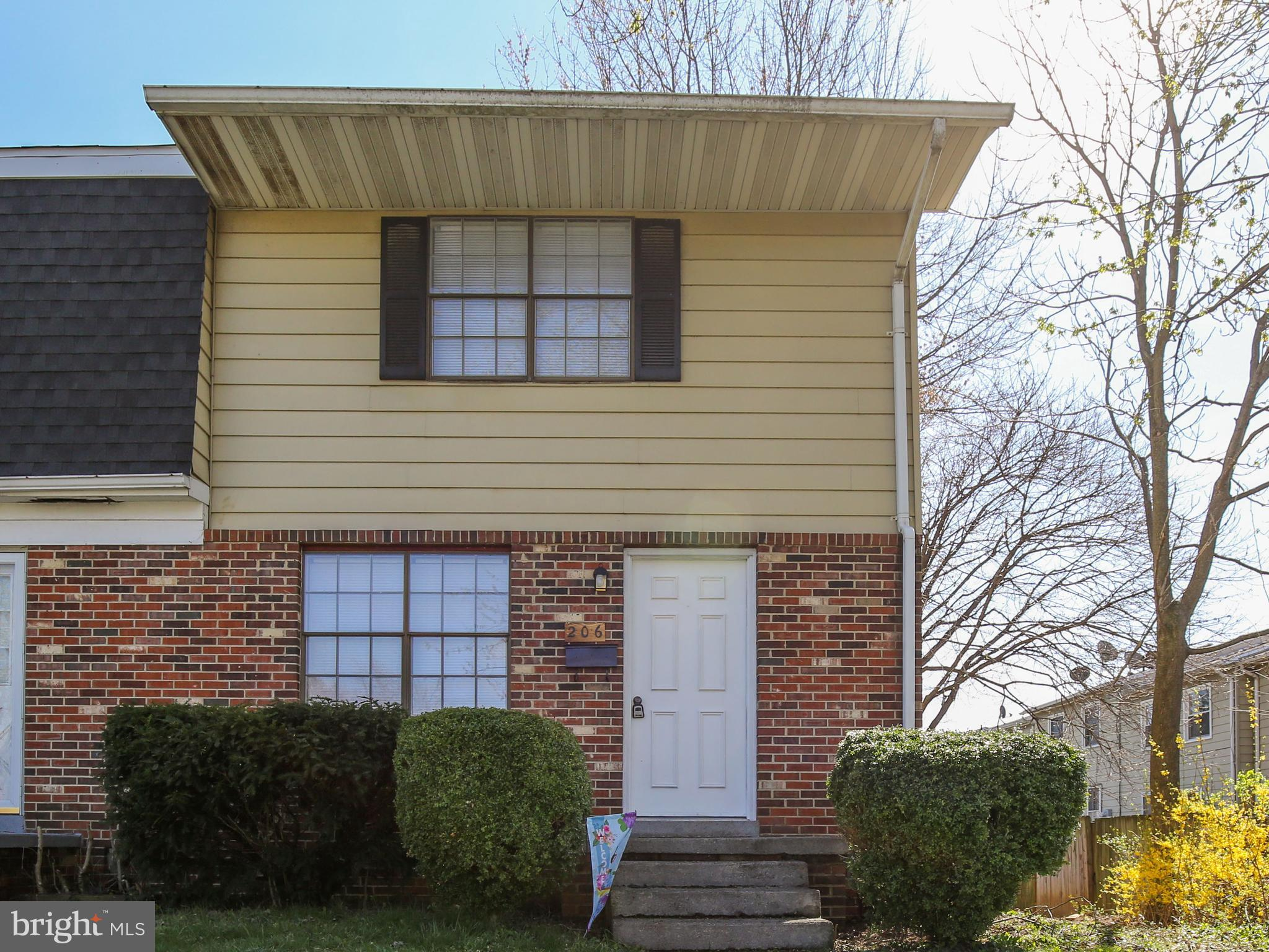 Great location!  Remodeled end unit townhouse offering 2 bedrooms, 1.5 baths.  New flooring througho