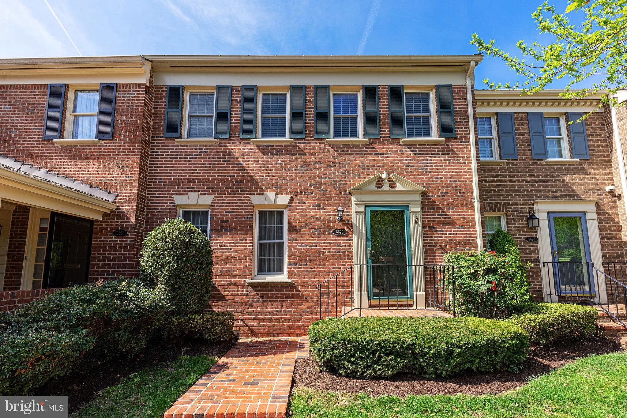 This Lovely All Brick Townhouse has been Updated w/Custom Finishes ~ Located in Sought-after Madison