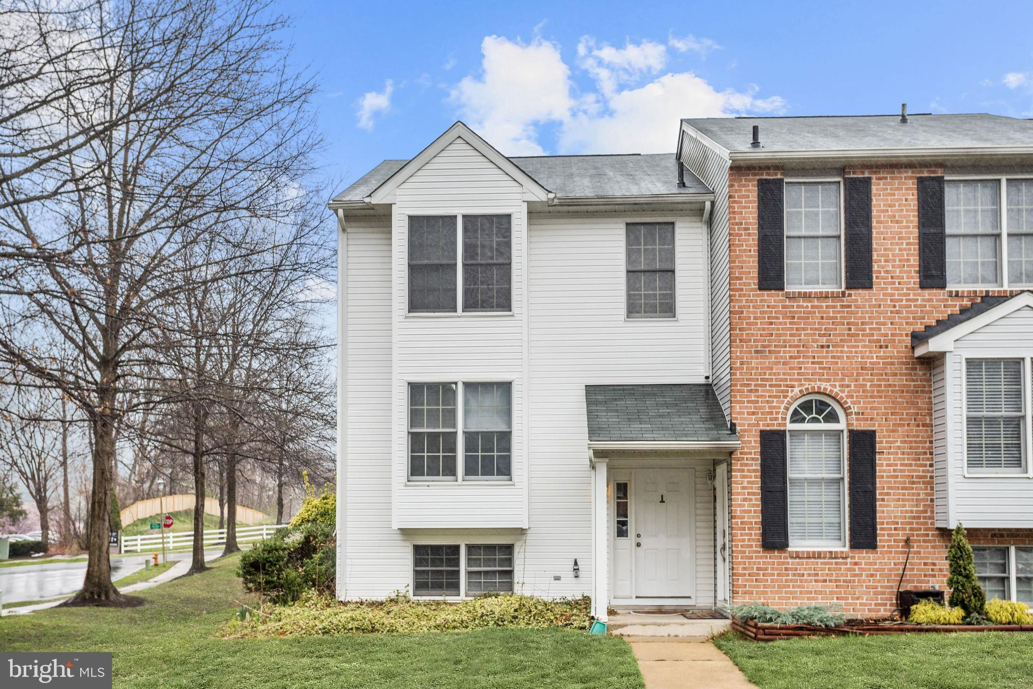Beautiful end of row townhome in the Wilder community of Ellicott City boasts many updates that incl