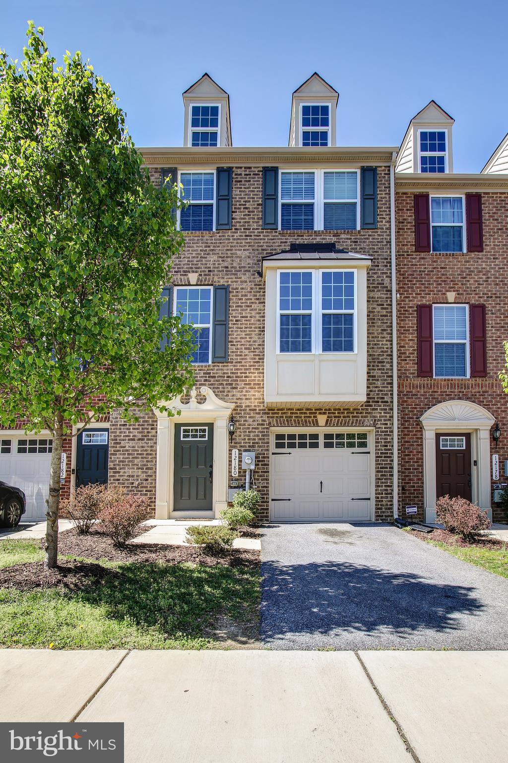 Sleek, upscale modern townhome in Adams Crossing awaits your pickiest buyers.  This brick front, 3 y