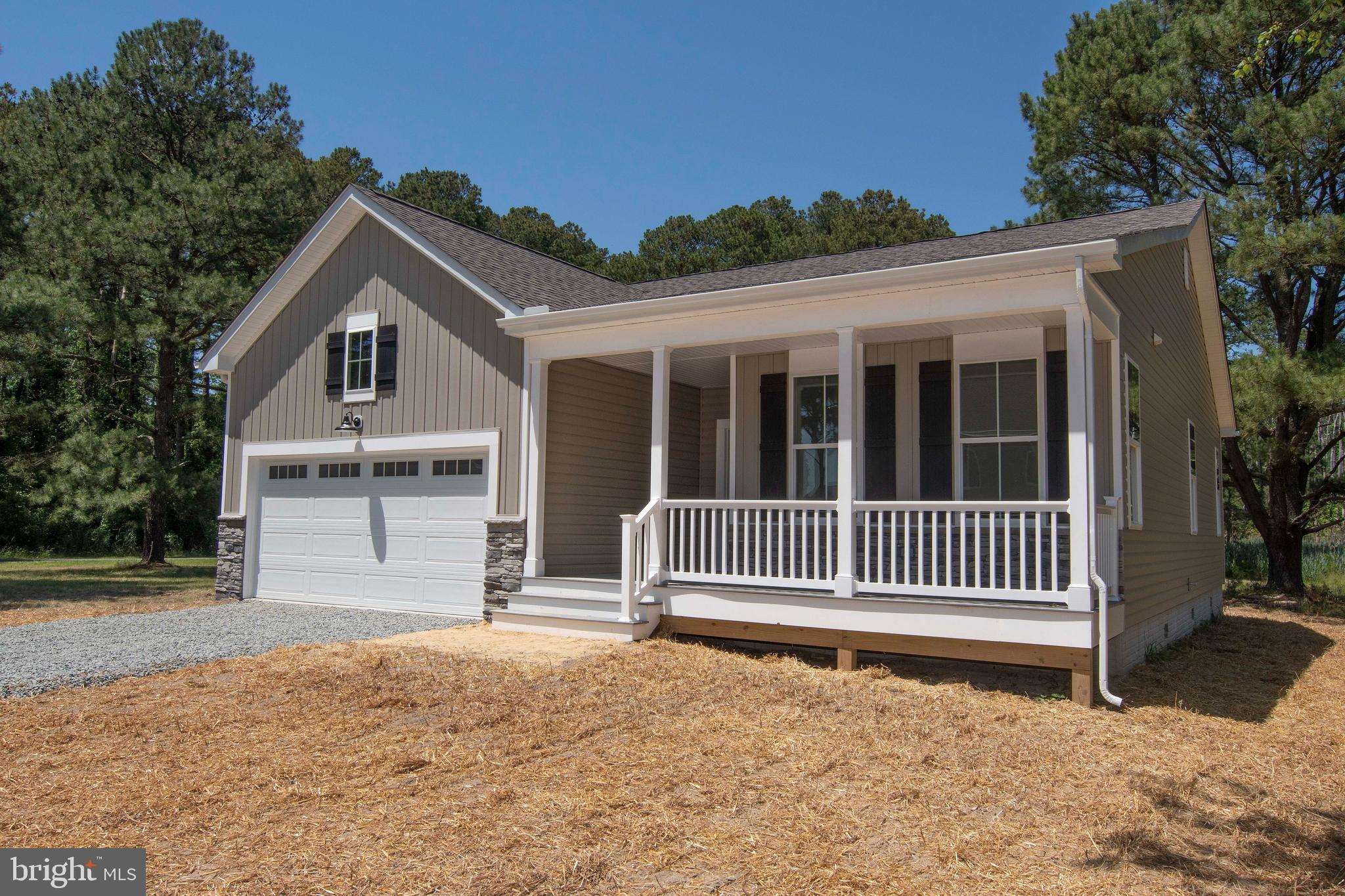 Enjoy scenic views of the adjacent canal from this spacious 3 Bedroom, 2 Bath rancher with 2-car gar