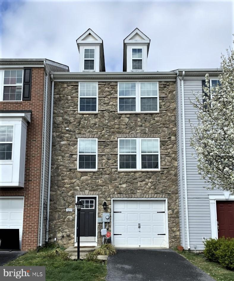 This well-maintained stone front Townhome is move in ready! Features include brand new living room c