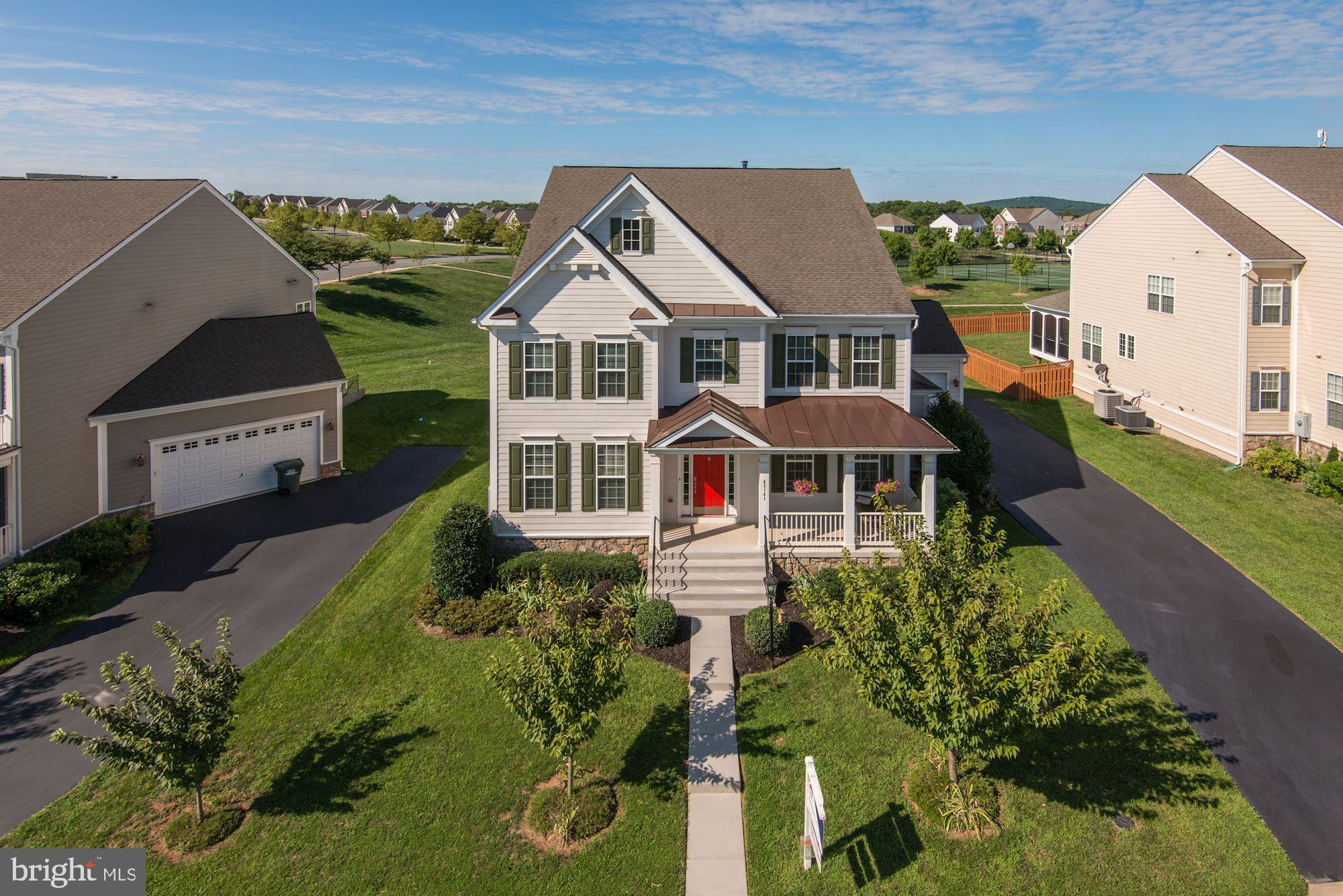 Immaculate move-in condition home has it all!  Almost 5,000 total sq. feet, Large .32 acre lot overl