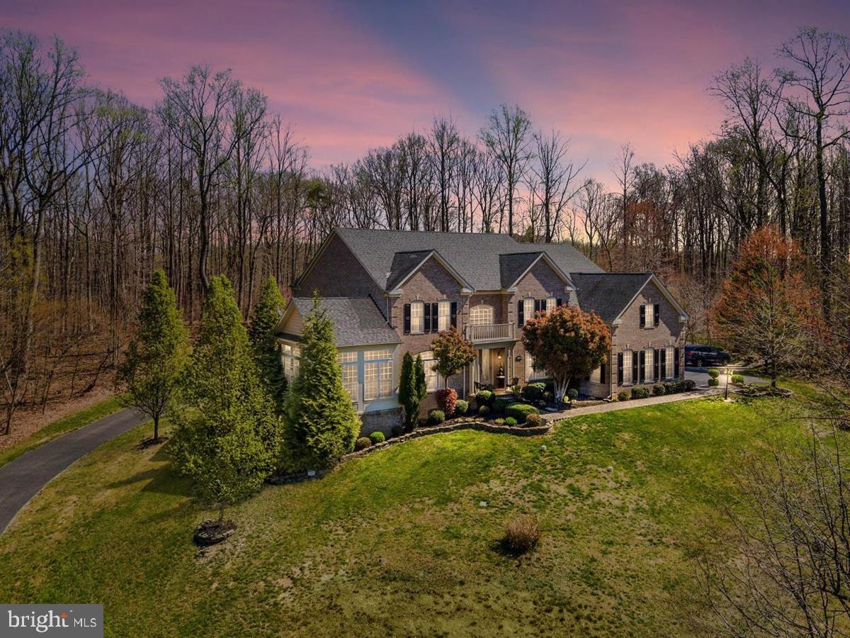 WELCOME TO PARADISE IN THIS ABSOLUTELY STUNNING ESTATE HOME SITUATED ON A MAJESTIC KNOLL! NO EXPENSE