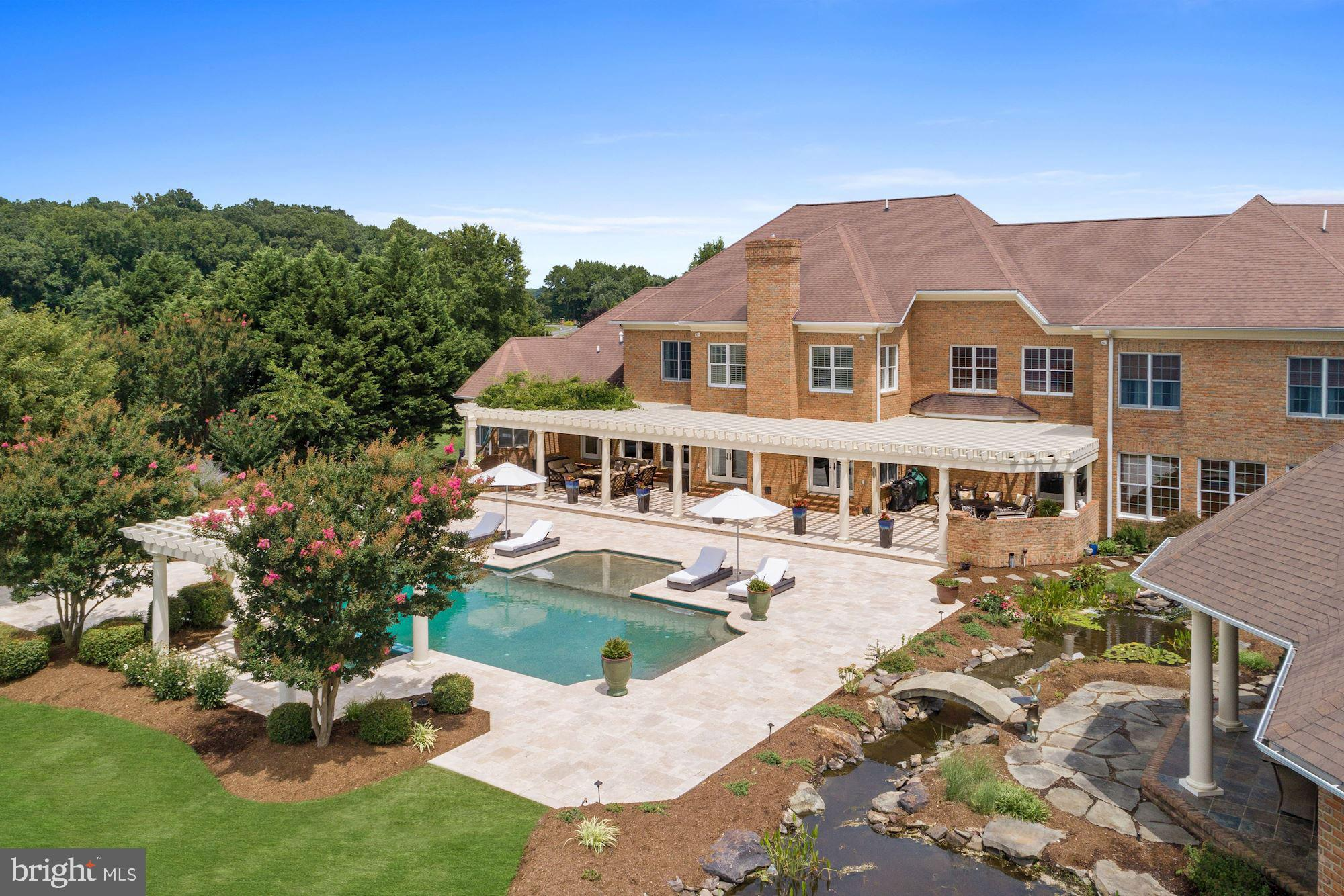 On an ultra-private peninsula with more than five verdant bay front acres sits this grand yet relaxe