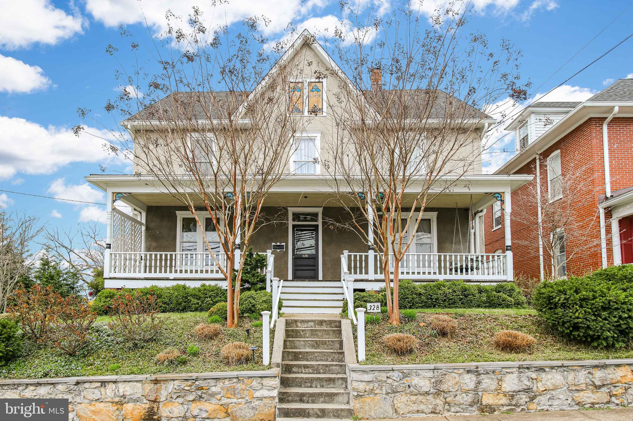 Beautiful Victorian Home with expansive front porch, and first/second floor rear porches with exquis