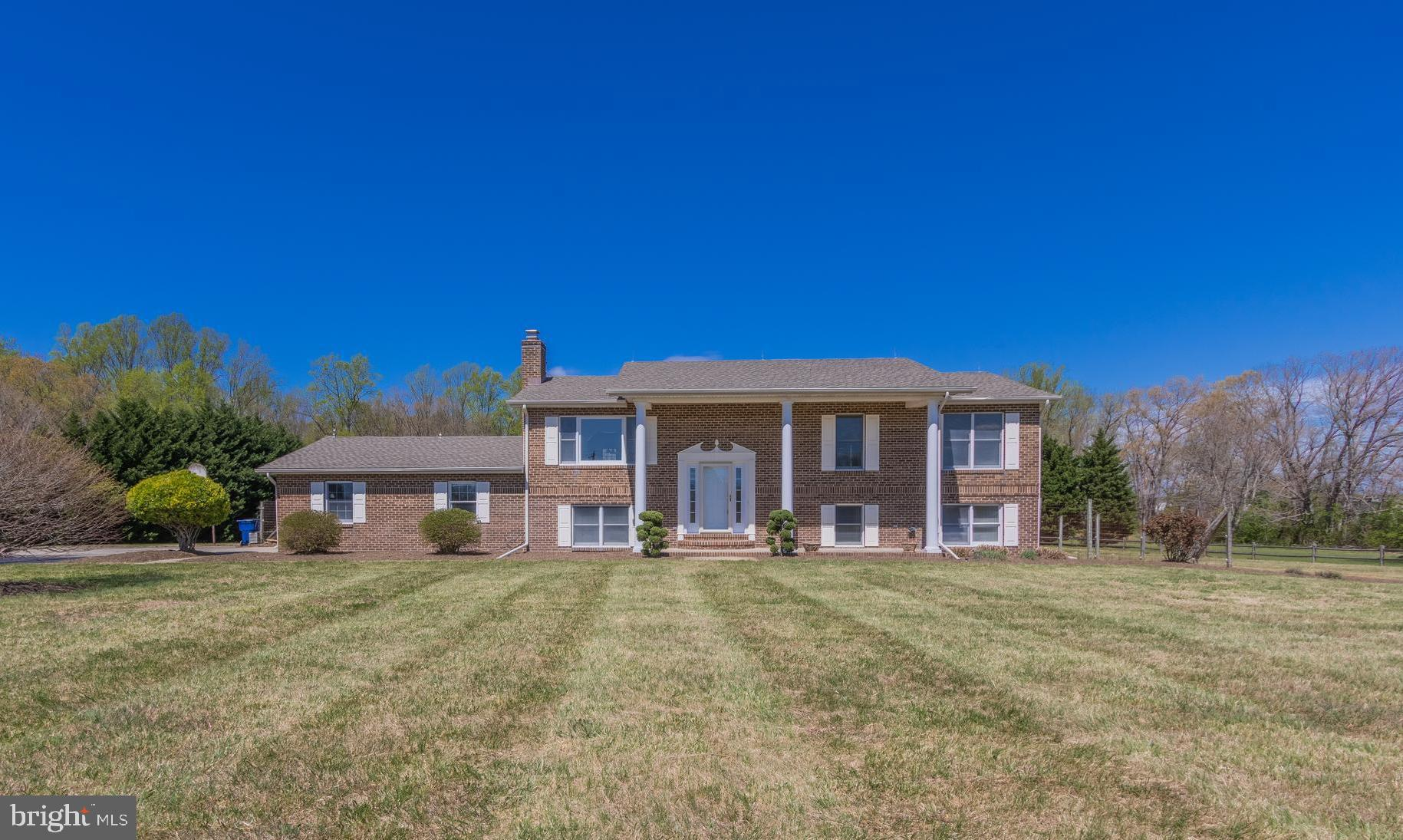 Beautiful brick front home on 4 acres cleared and level for your recreational enjoyment! 4 bedrooms