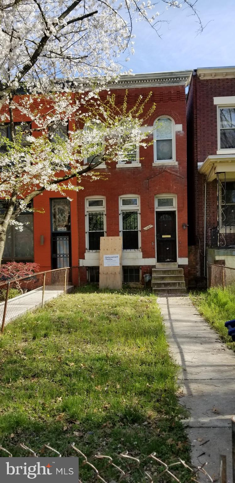 This brick rowhouse is on an unusually deep lot.  The front of the home retains most of it's origina