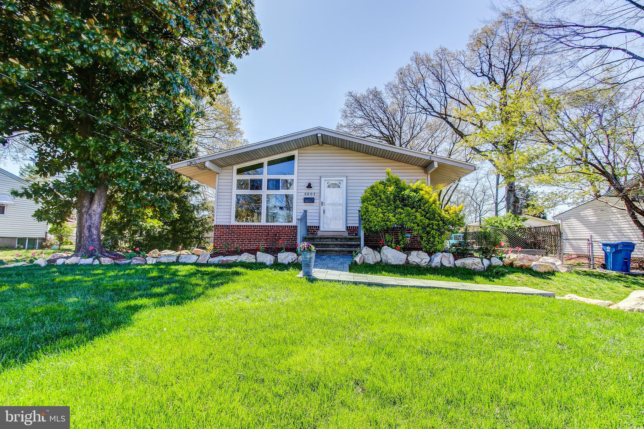 Stunning single family home. Spacious landscaped fenced-in backyard complete with a deck and a shed.