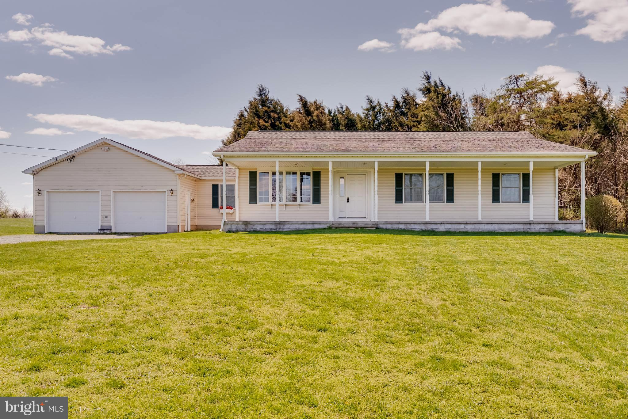 Lovely spacious ranch style home ( w/approx. 1872 sq ft.) ,situated on just under 5 acres not in a s