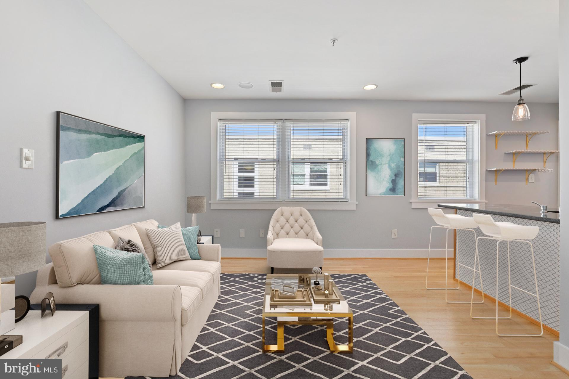 Charming Columbia Heights condo featuring 1 bed/1bath. This sun-drenched, top floor unit boasts an o