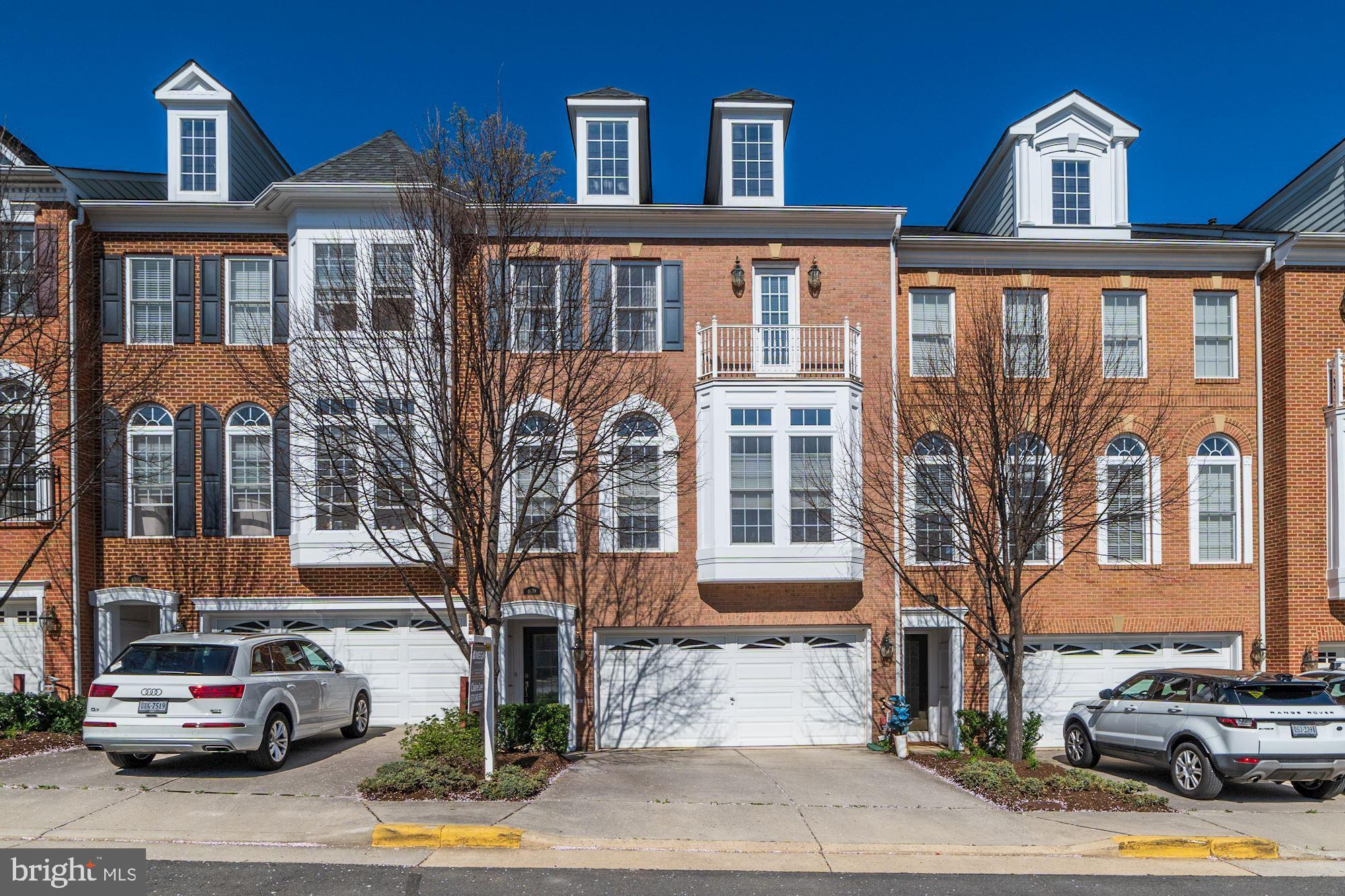 Gorgeous brick-front townhouse condo minutes from 66, 50, and 29! 2-car garage and Full bed and bath