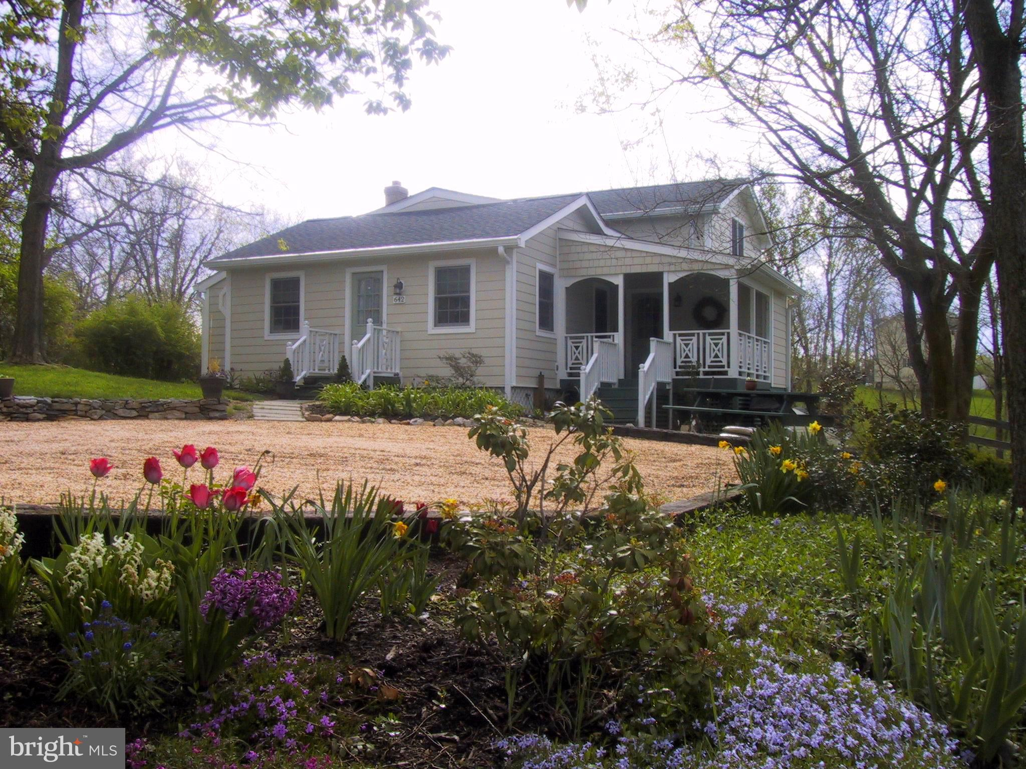 RARE FIND in the Heart of Historic Millwood! This 1951 Cottage has a 2006 3-level addition  designed