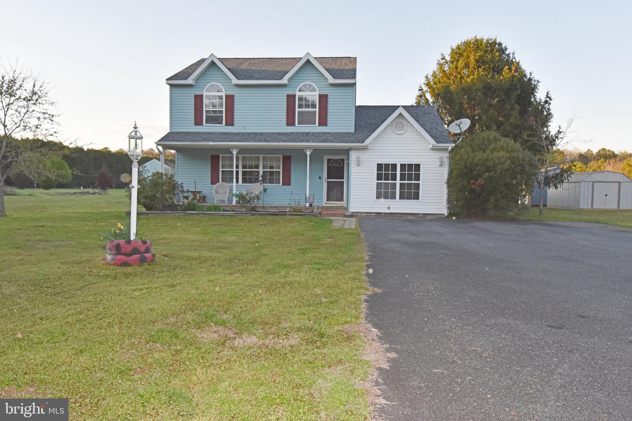 This rural beauty could be yours!   The home features three bedrooms, two full bathrooms, a remodele