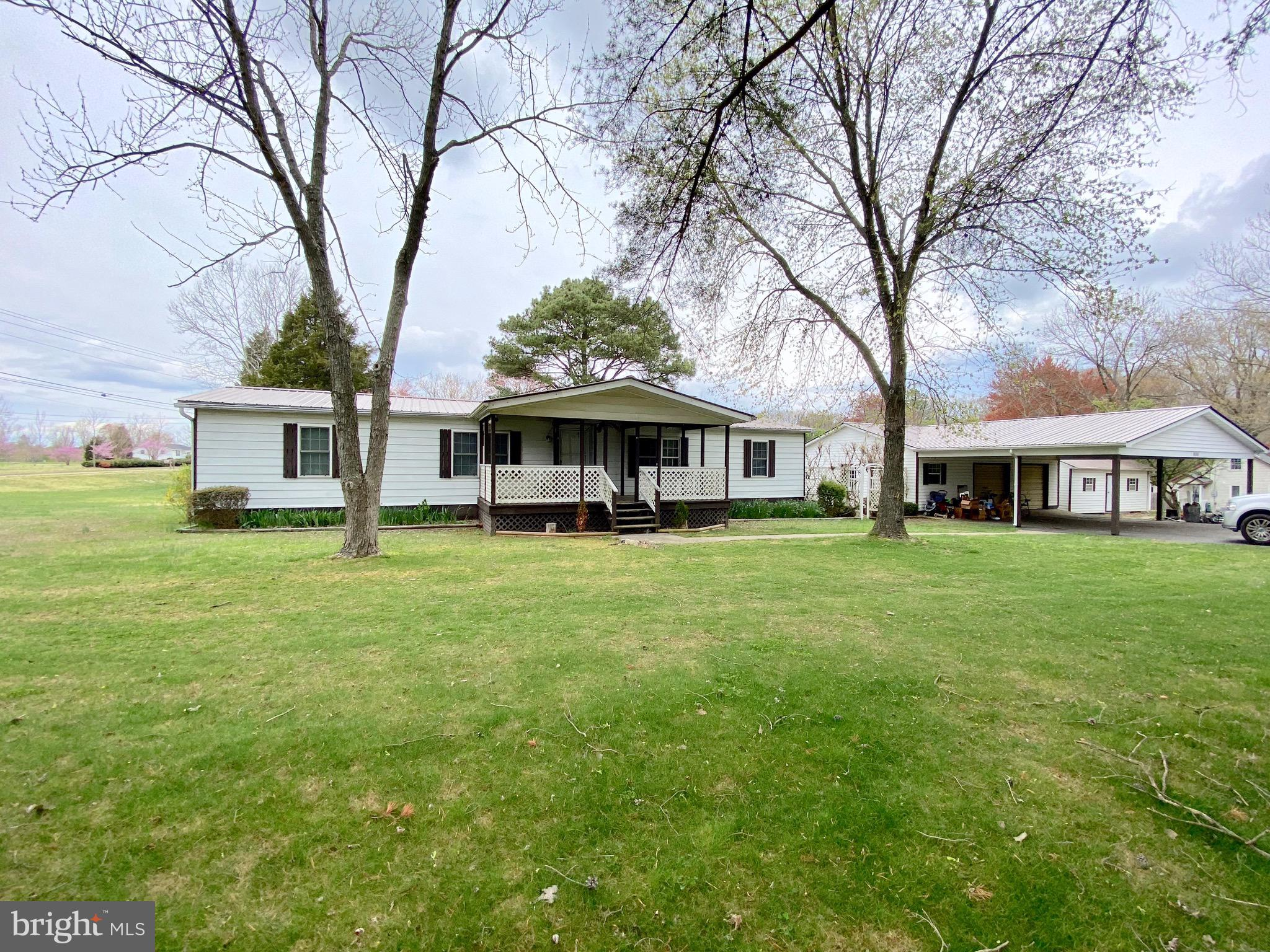This very well-maintained home has a detached two car garage and a large storage shed that will conv