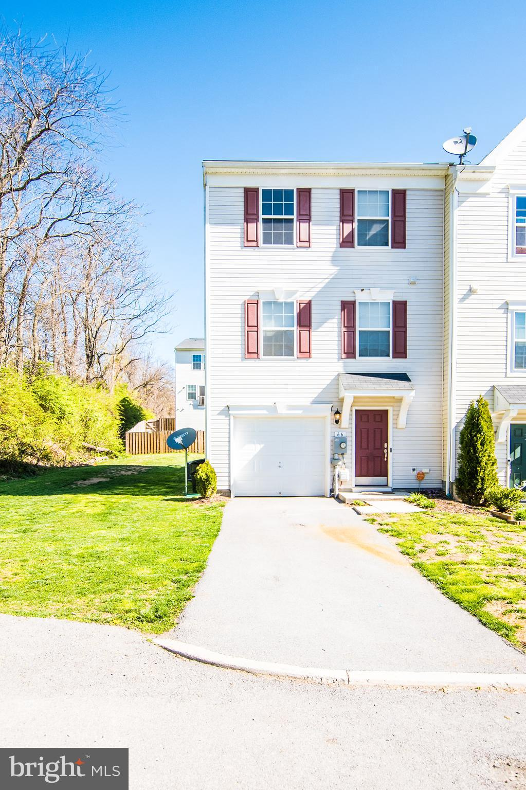 End unit garage townhome with 12' bump out on 3 finished levels! 3 bedrooms and 2 full/2 half baths