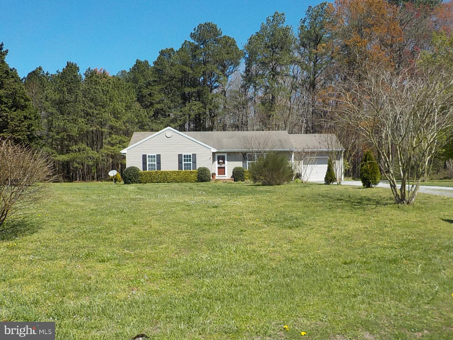 Home Sweet Adorable Home!  Three Bedroom,  2 Bath  home with attached garage on 1.04 acre!  Living R