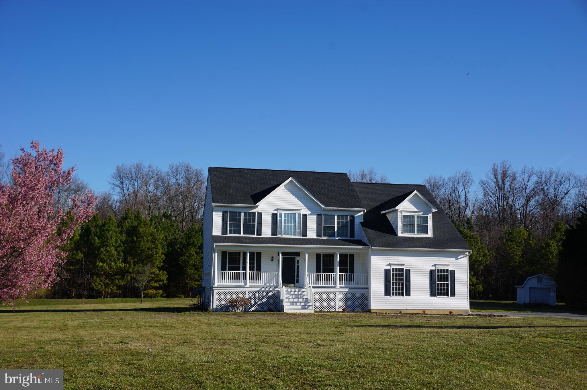 Welcome to your new home! This immaculate colonial is situated on over an acre of land just outside