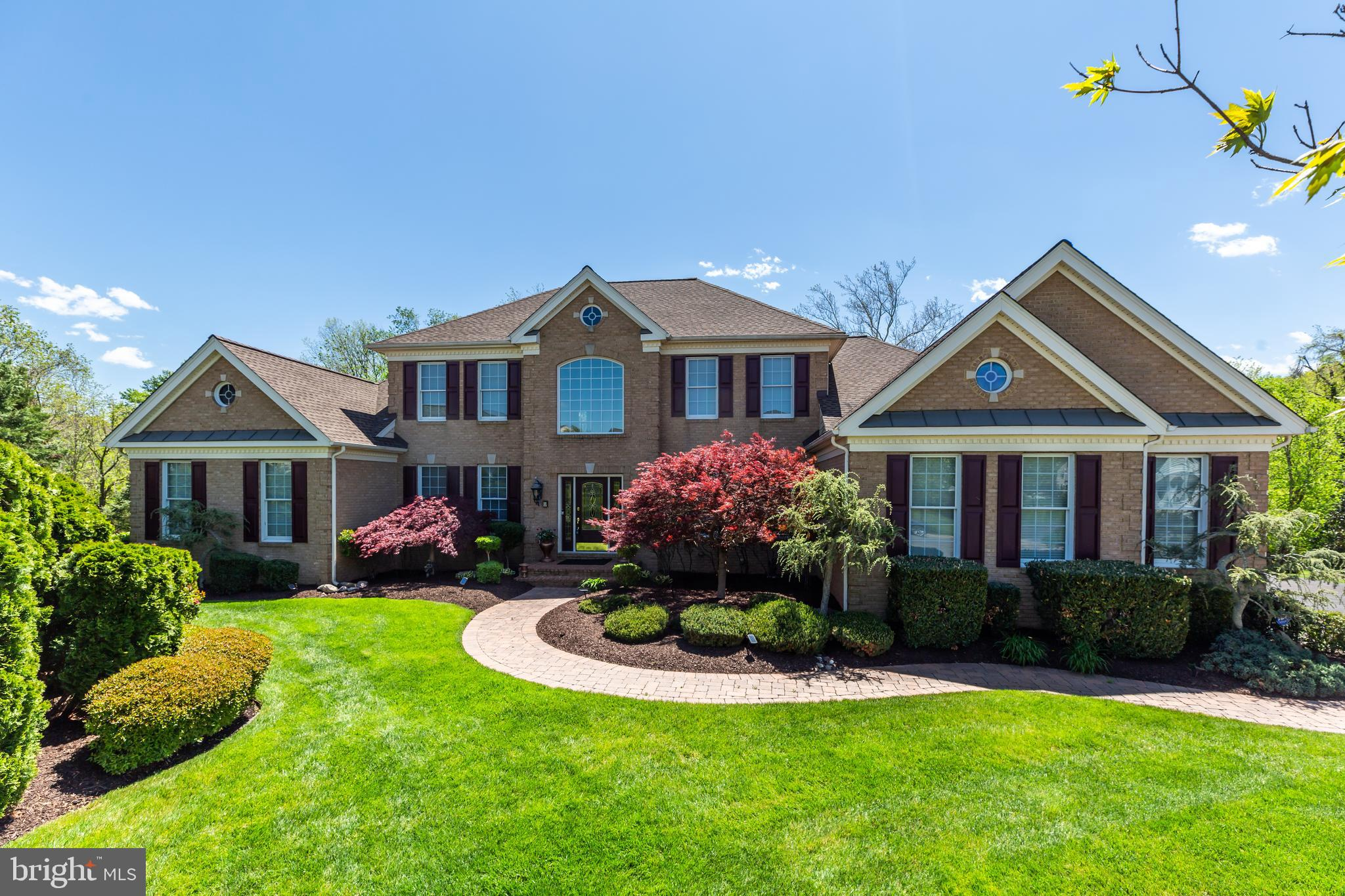 Phenomenal Estate Home behind the gates of Dominion Valley Country Club.~ The Spacious Main Level Ma