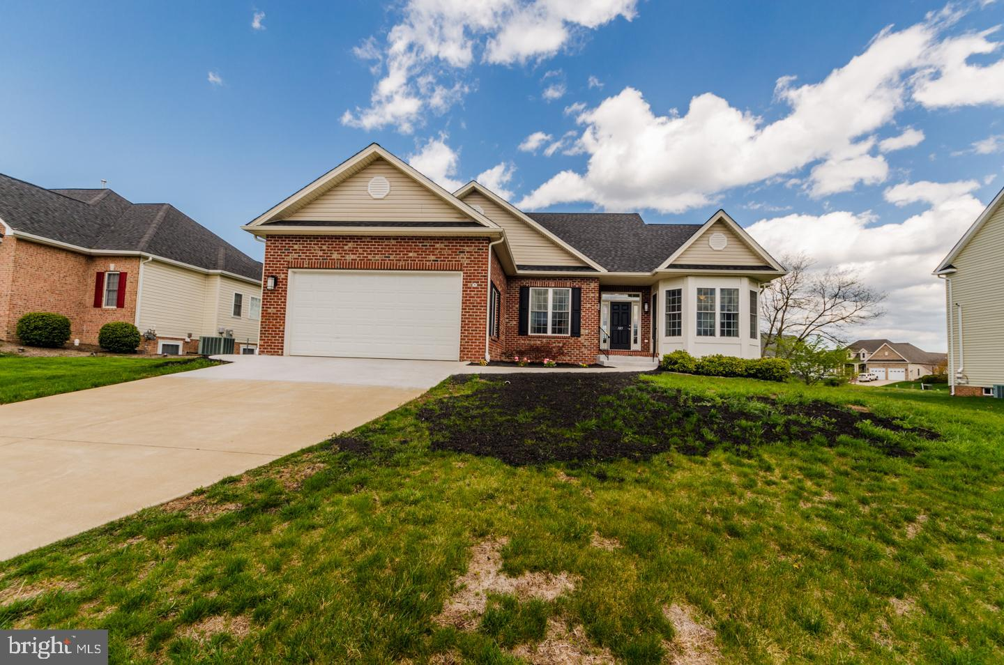 This beautiful home is ready to move it! As you enter the side walk you will pass by beautiful lands