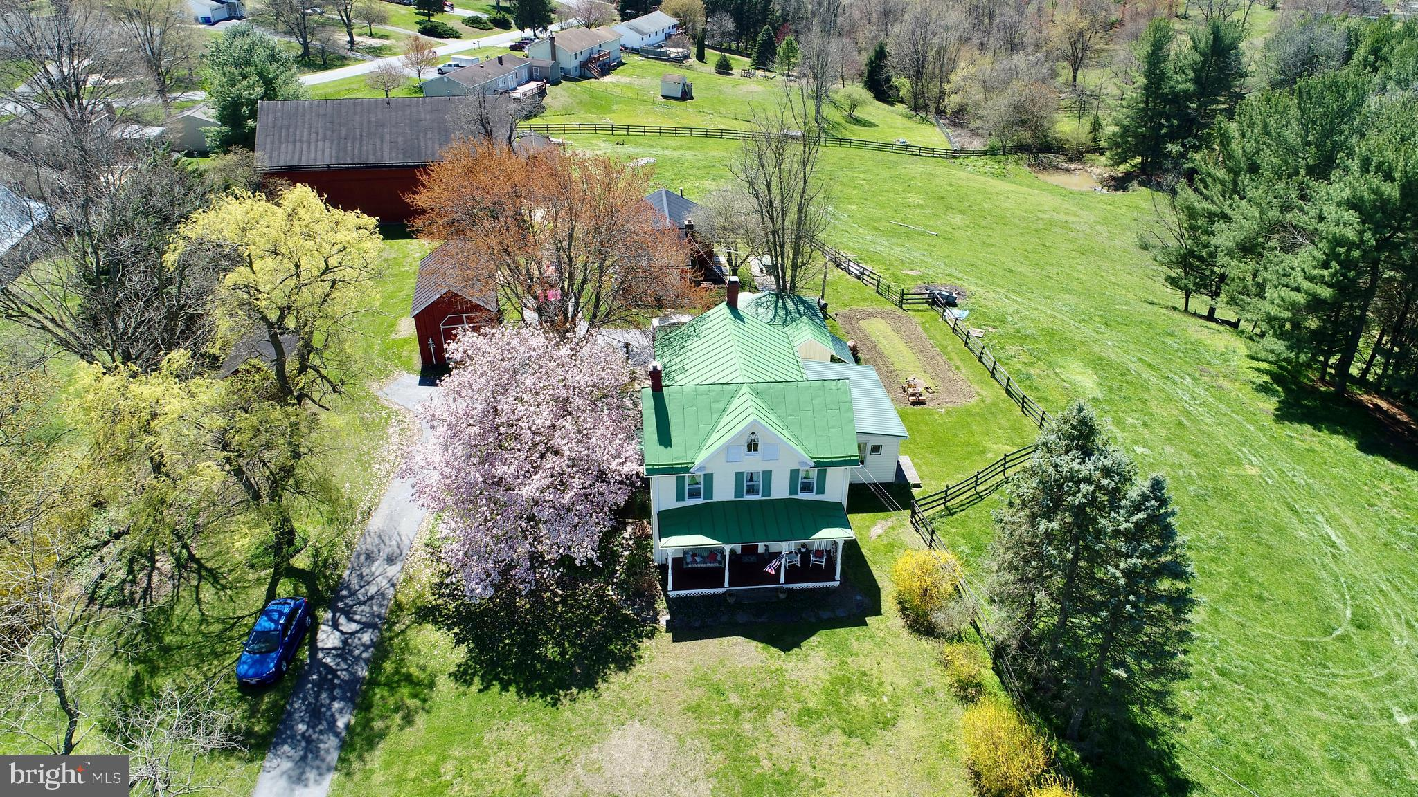 Historic Farmhouse resting on 3 fenced acres of beautiful rural farmland.  This property has unlimit