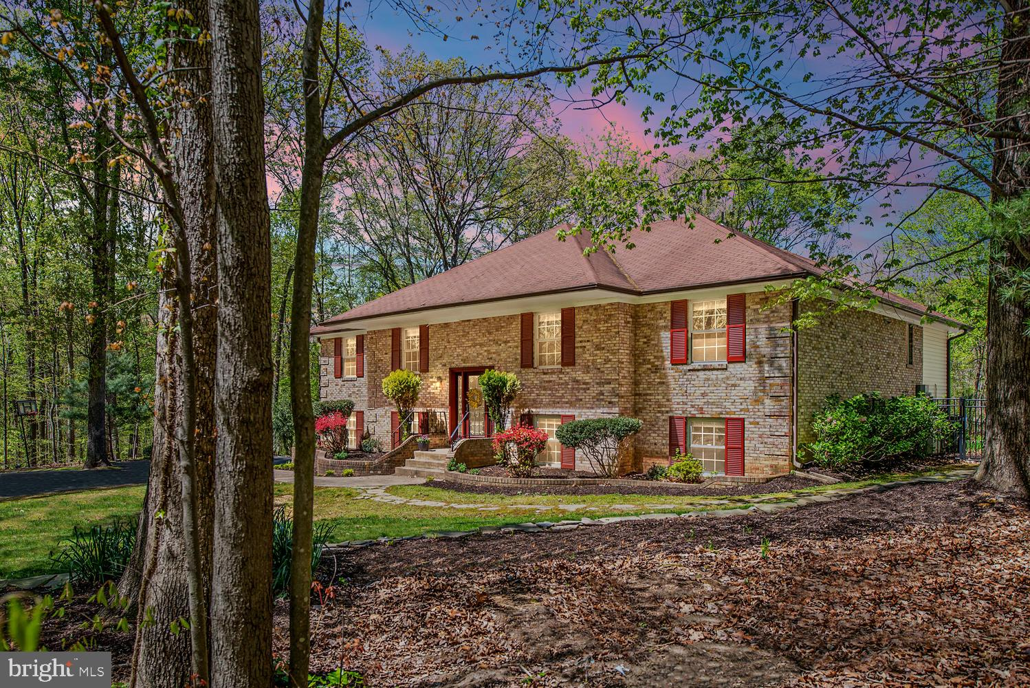 Welcome home! Charming updated home with 4 bedroom 3 full baths nestled on 1.82 acres in enchanting Woodbine Woods. Lovely professional landscaped yard with beautiful hardscaped finishes in the backyard. Open floorplan with formal sitting room, dining room, and a kitchen that opens to family room. Off the family room there is a screened porch over-looking the backyard and pool. Family room has a wood burning fireplace great for those cold winter nights. There is a large deck off the kitchen for grilling and entertaining after a long day. The kitchen has two ovens, extra ice maker, large pantry, stainless steel appliances, custom cabinetry, and granite counters. All bedrooms have closet systems for convenience and ease. All three bathroom have been newly remodeled. The lower level is great for entertaining! Large recreation room with space for home theatre, pool table and a dry bar area. Basement has utility room with newly purchased washer and dryer. Basement has a walk-out door to the backyard. Outside are two storage shed. Gorgeous in-ground pool great for those hot summer days.  Absolutely stunning home and property. No HOA. Sought after school district, Coles ES, Benton Middle and Colgan High. Close to commuter routes, 95, 66, and the Manassas VRE station is 7.5 miles away.