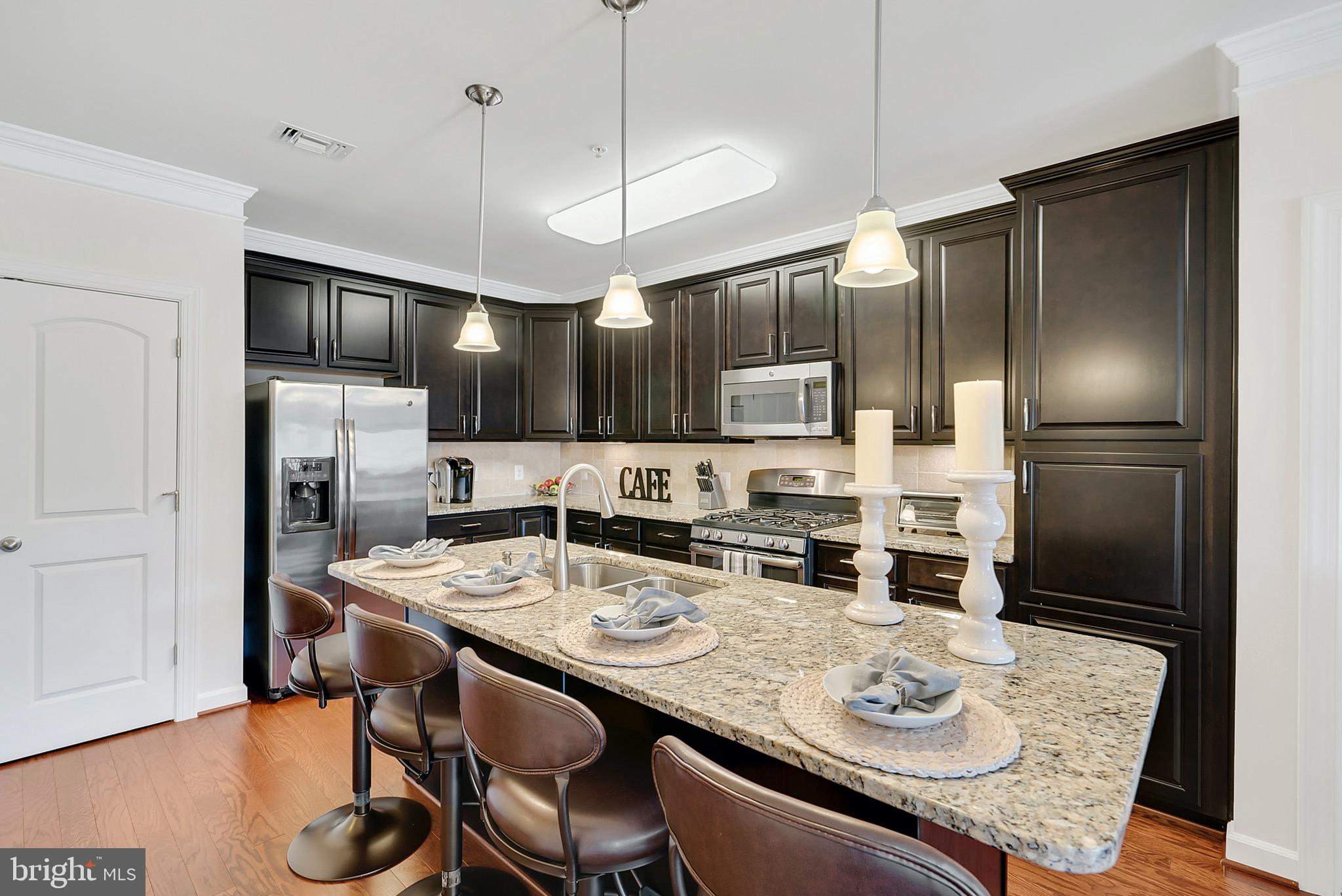 This fantastic penthouse level condo is like new construction!  Quiet with no one above you, this fa