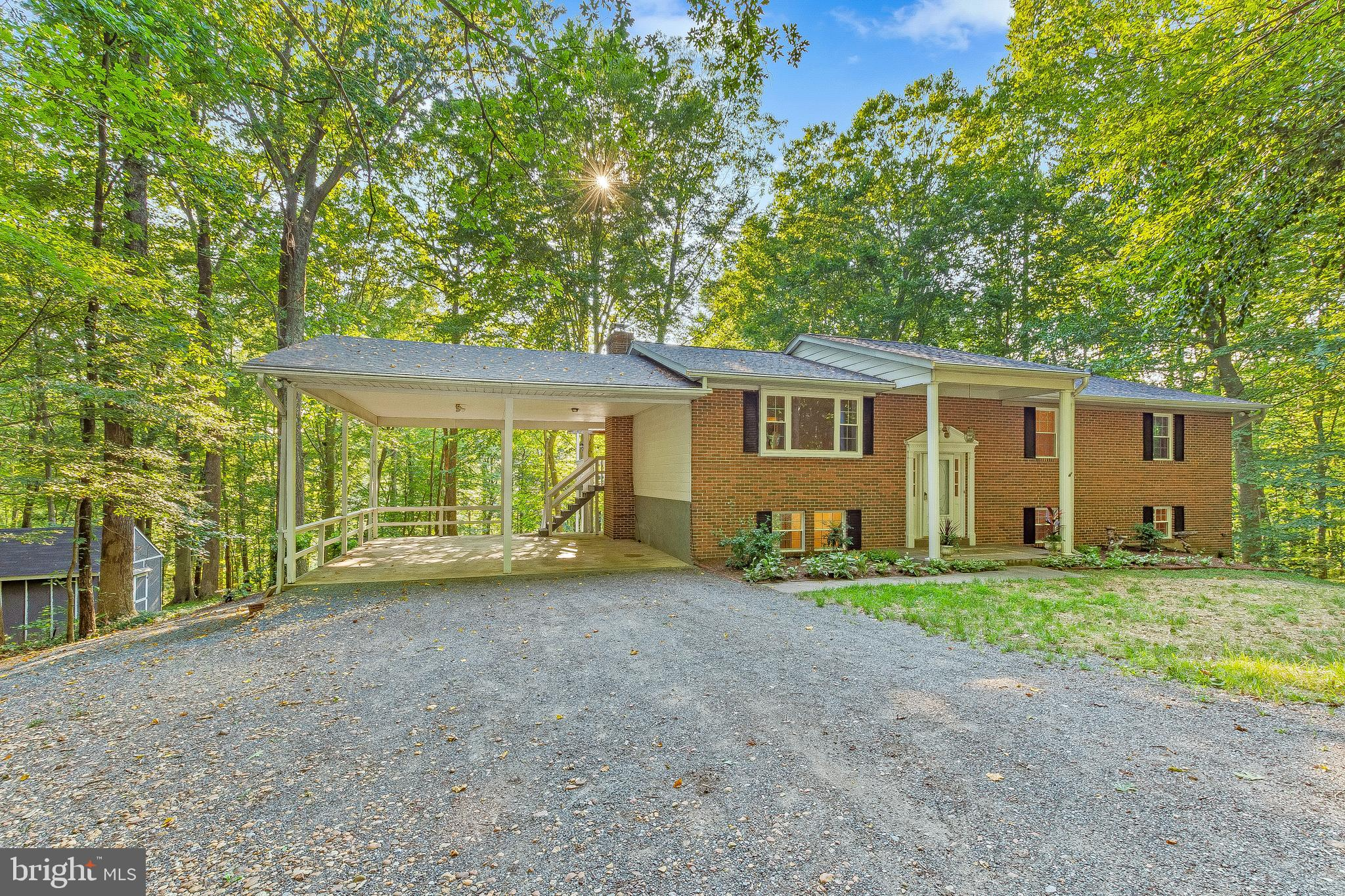 SEVEN (7.09) Acres provides you with your own 'Wonders of Nature' and 'Room to Roam' in this NORTH C