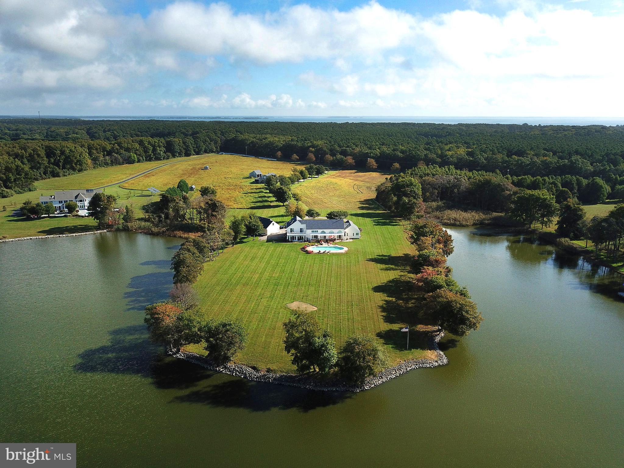 Magnificent Kent Island Waterfront Estate on 15 landscaped acres. This Post and Beam Home offers ove