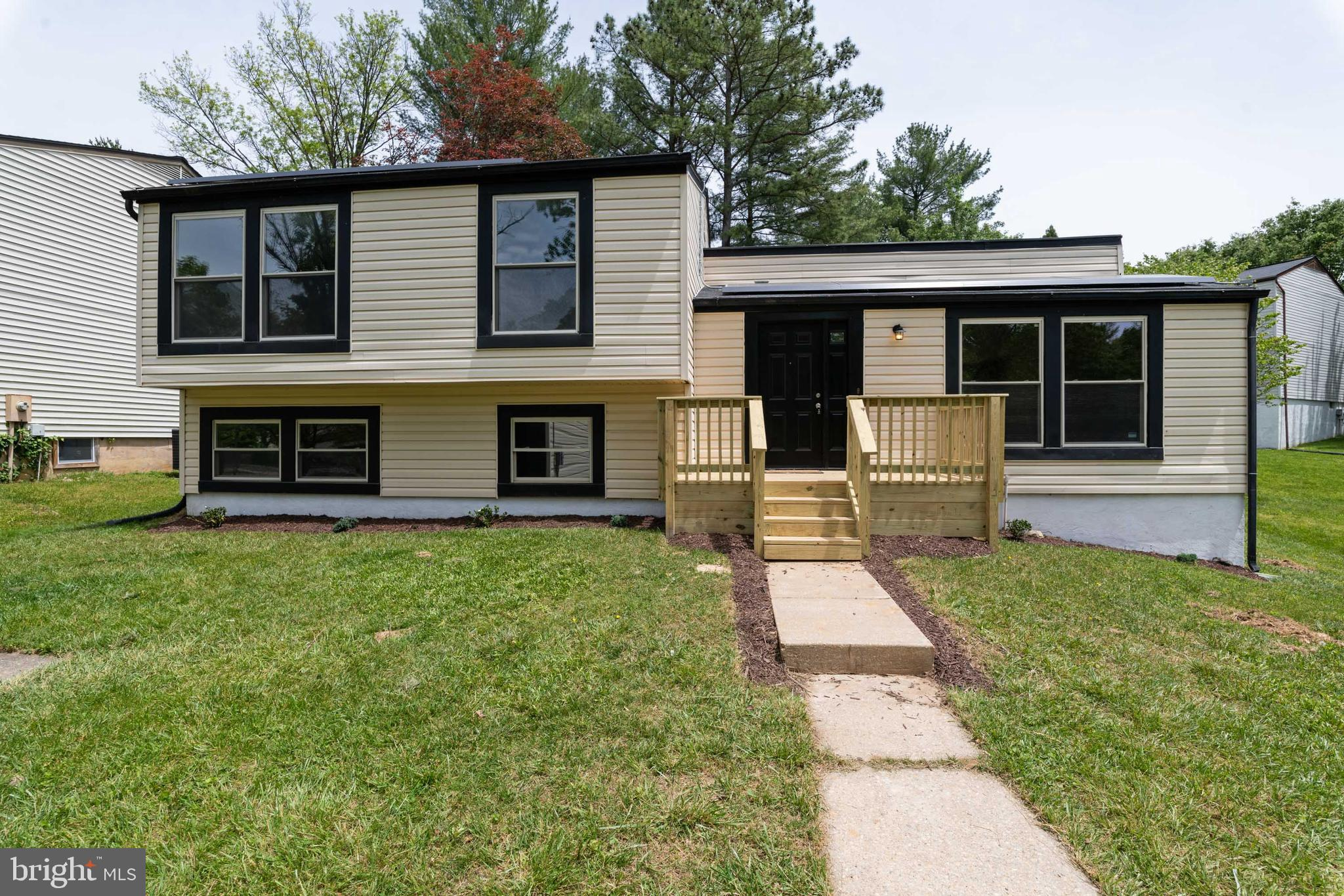 renovated - new kitchen, new bathrooms, freshly painted, new flooring, new deck (front and rear) - l