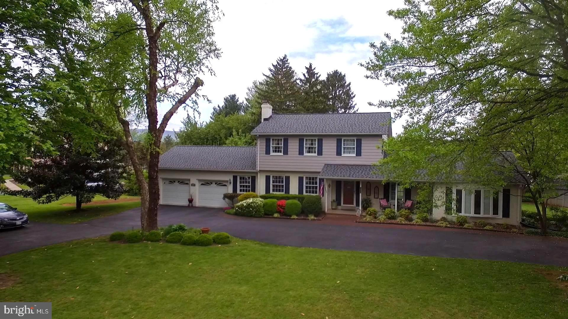 Sought after Clover Hill corner lot with circular drive! These don't come around often. This large A