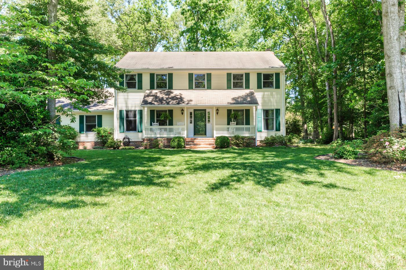 Lovely 4 bedroom, 2 1/2 bath home. Bedrooms are all large. Beautiful hardwood floors. Brick fireplac