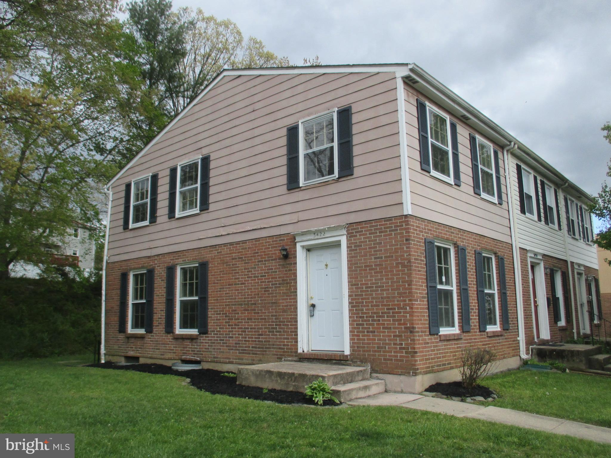 **NEW PRICE** End Unit Townhome with Partial Brick Exterior.  Living Room with Separate Dining Room
