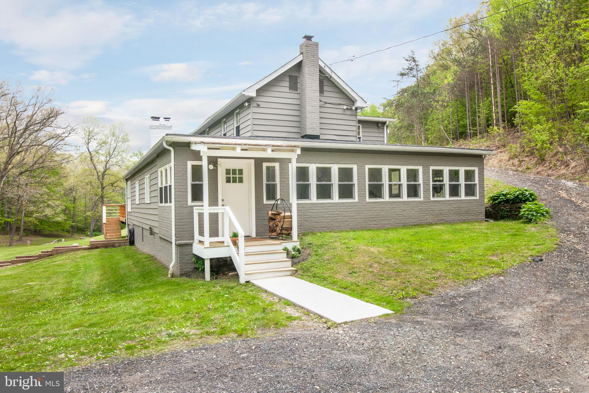 This is a must see!!  Beautifully Renovated Craftsman Style home w/over 12 acres of land. Hardwood f