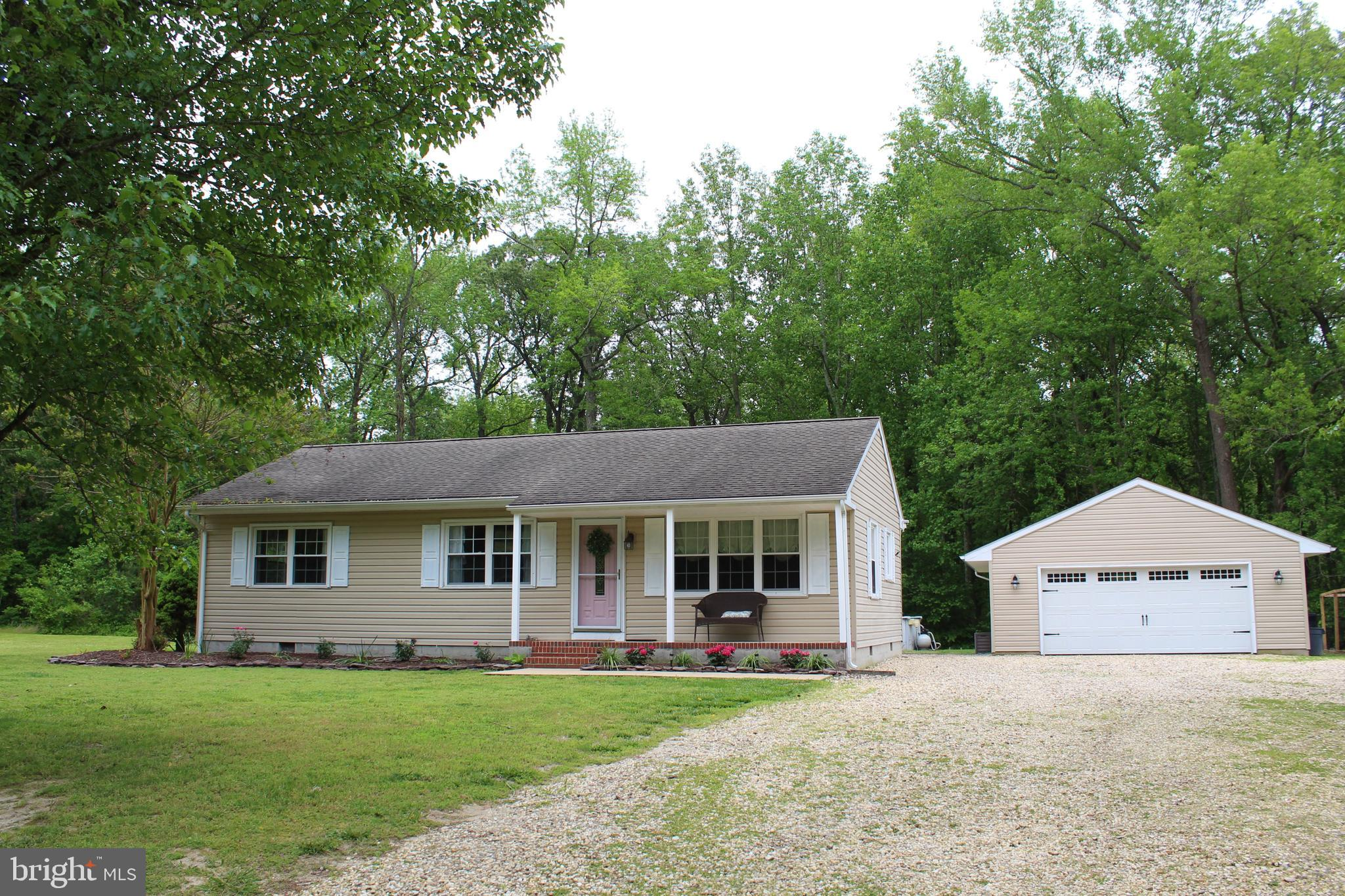 This charming home features an updated kitchen with SS appliances, bright living room, open dining,