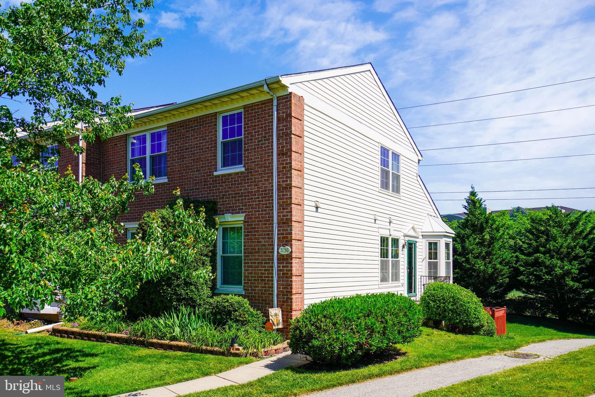 Don't Miss this lovely End Unit, Side Entry Townhouse w/ Rare 1st Floor MBR w/ Full Bath. Lovely Kit