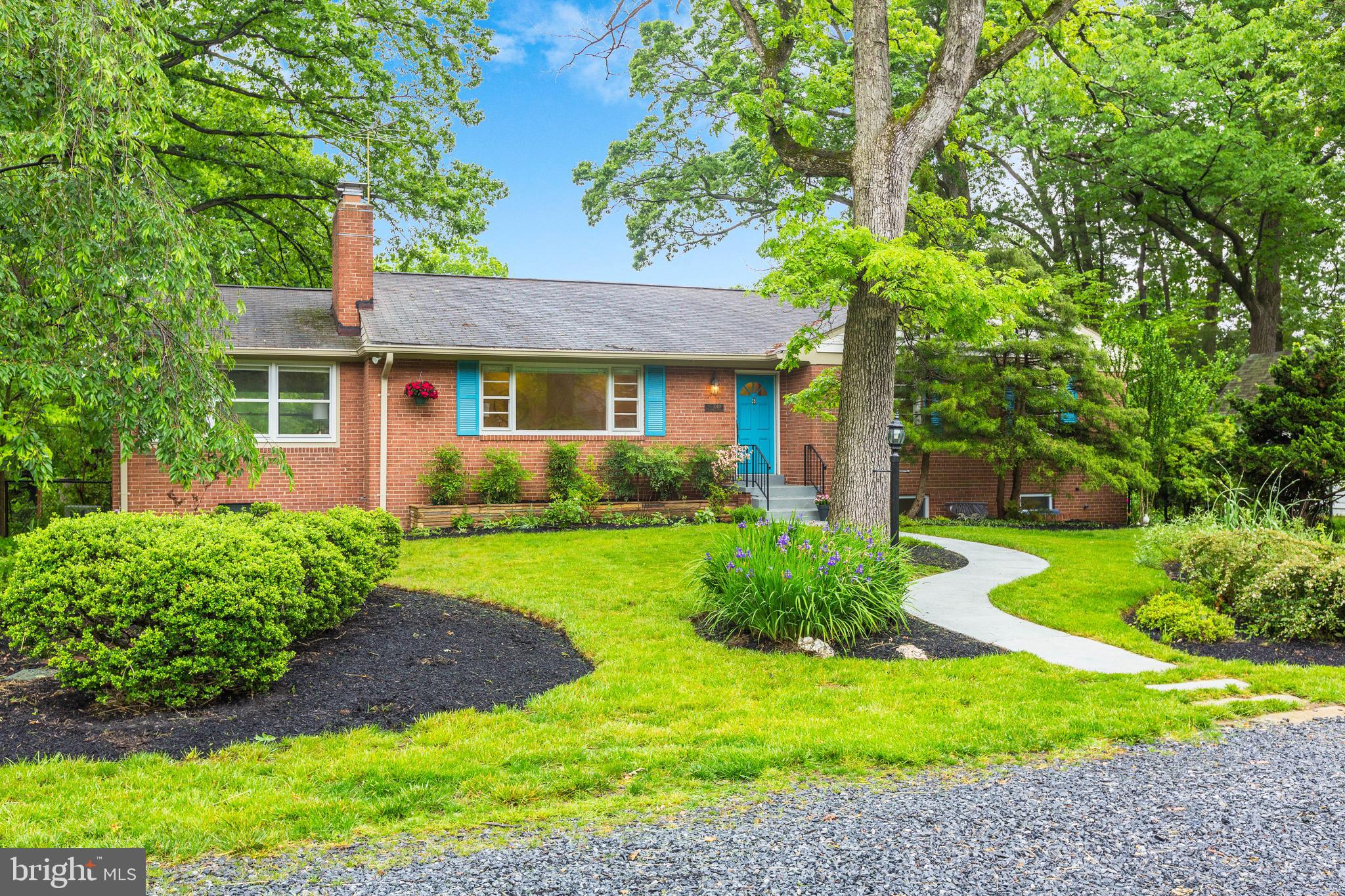 Tucked away among mature flowering plants, this remarkably private home is ready for your enjoyment