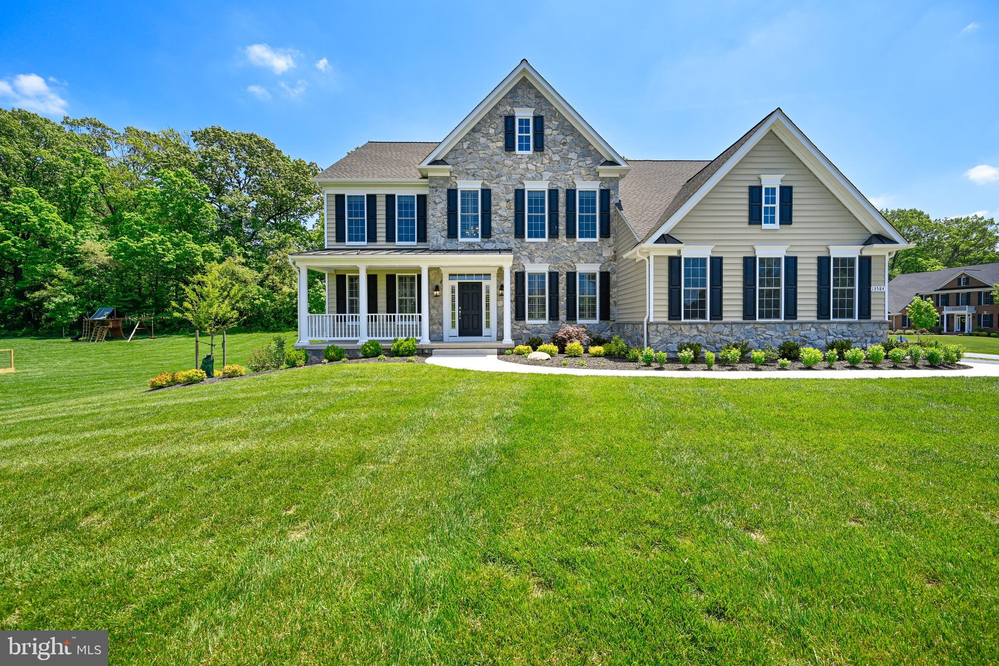 Fabulous 5 bedroom, 4.5 bath colonial in prestigious  Estates at Cloverfield!  This nearly new home