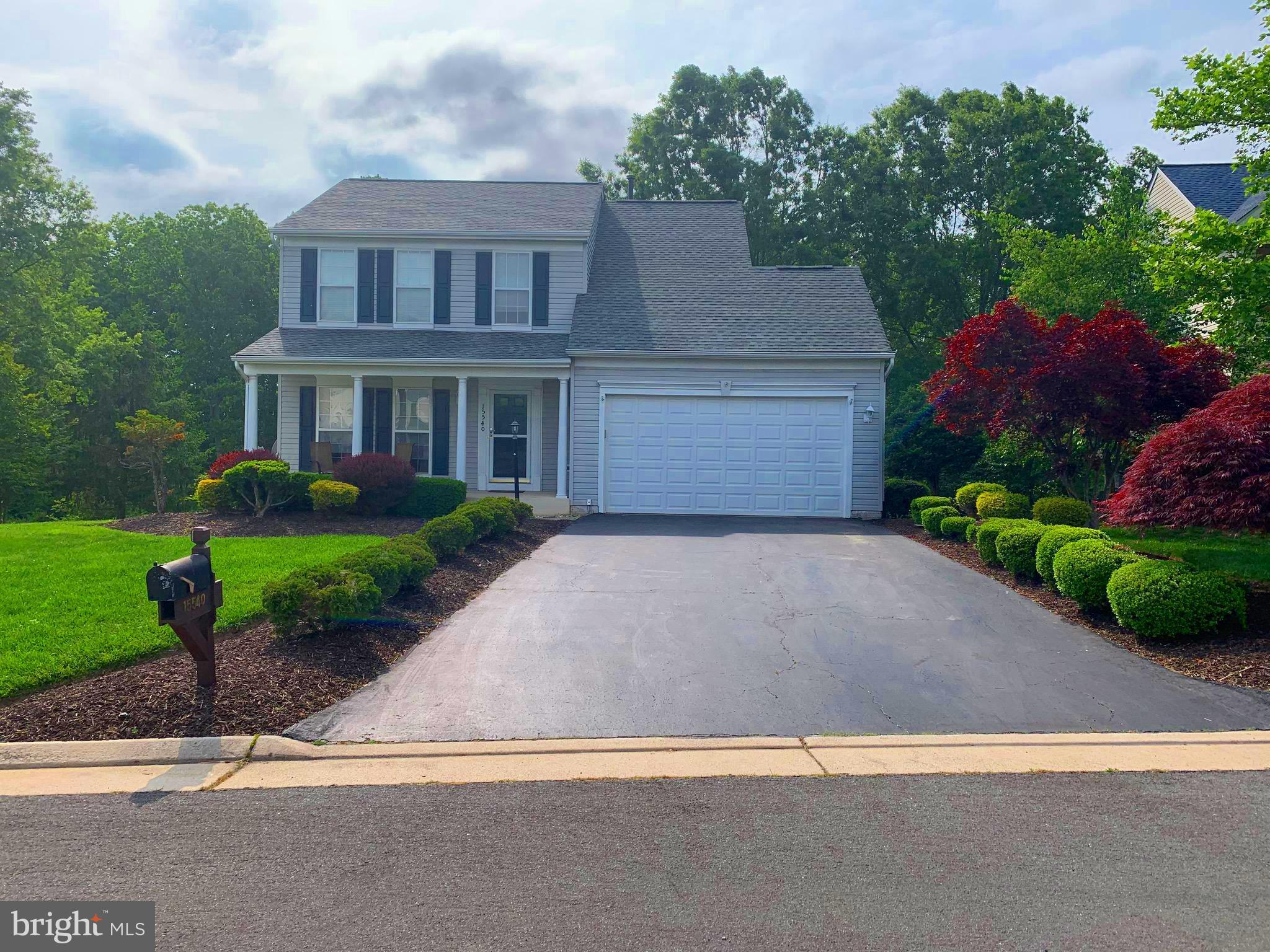 Beautiful family home in highly desired Dawson Landing neighborhood, just minutes from the water and VRE commuter train and lots of walking trails, including Neabsco Park & Boardwalk.  Just a short drive from  Quantico Marine Base and Fort Belvoir. Open layout with kitchen that has granite counter tops  & hardwood floors on main level. Large Walk-in Closet in Master Bedroom. Screened & spacious deck with patio offers perfect space for outdoor entertaining. The fully finished walk out basement leads into a huge yard & beautiful landscaping.  Roof was replaced in 2018, updated Lawn Irrigation System and  Ceiling Fans.  Home also features a water filtration system. The fully customizable garage wall organization system with rolling work bench is any Handyman's dream!  Nearby shopping & restaurants via Potomac Town Center & Potomac Mills Mall. Please schedule showing with at least 2 hours notice - 9 am - 8 pm - 7 days a week -Lockbox Combo.
